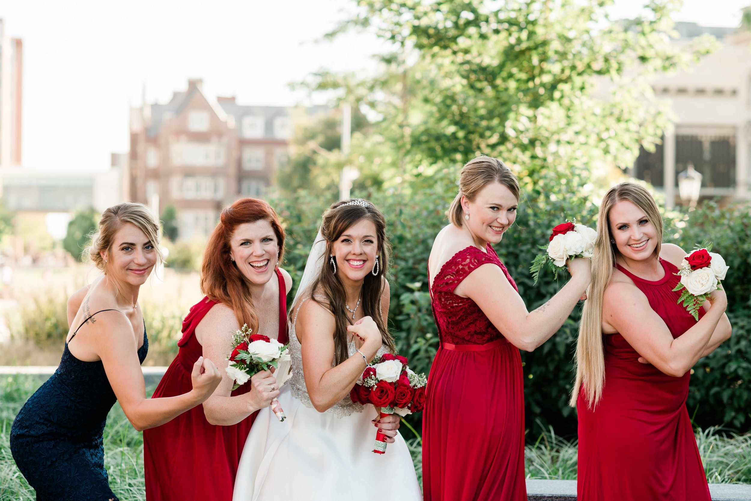 Bride and bridesmaids show off their biceps
