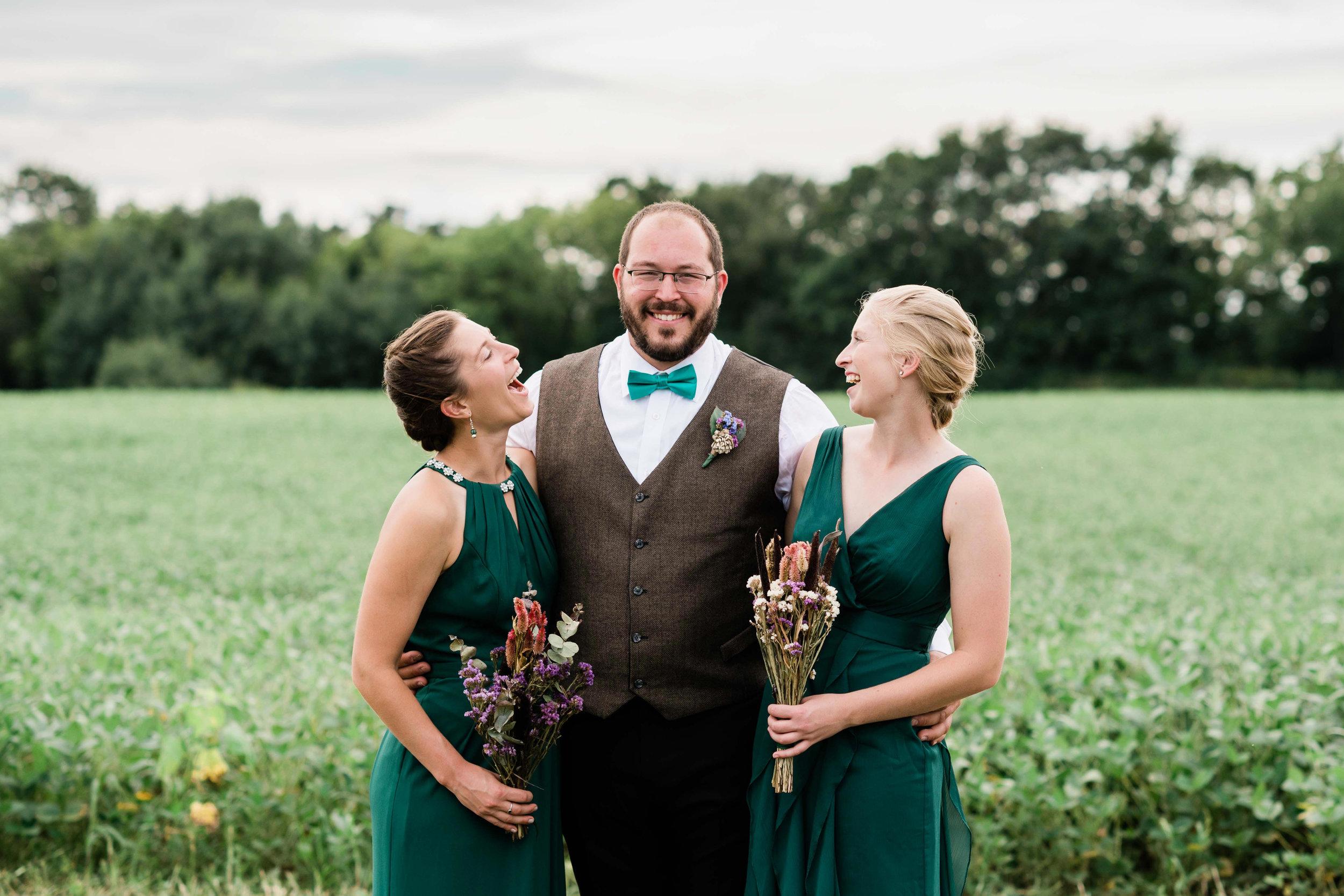 Bridesmaids admiring groom