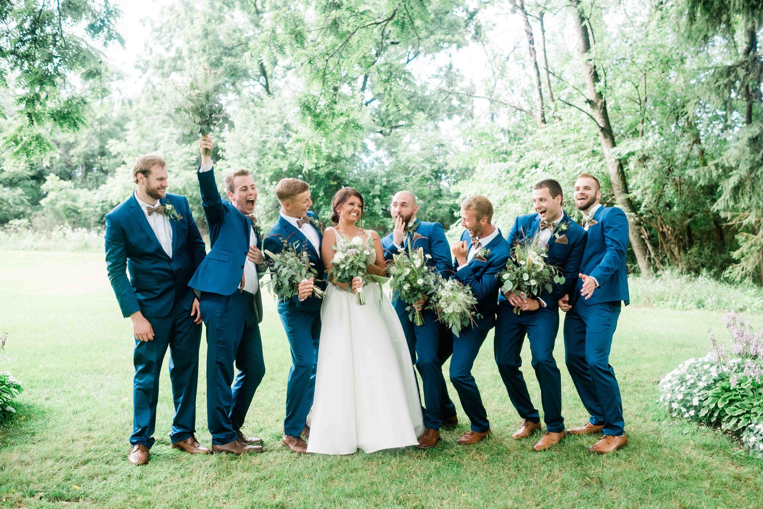 Bride goofs off with groomsmen