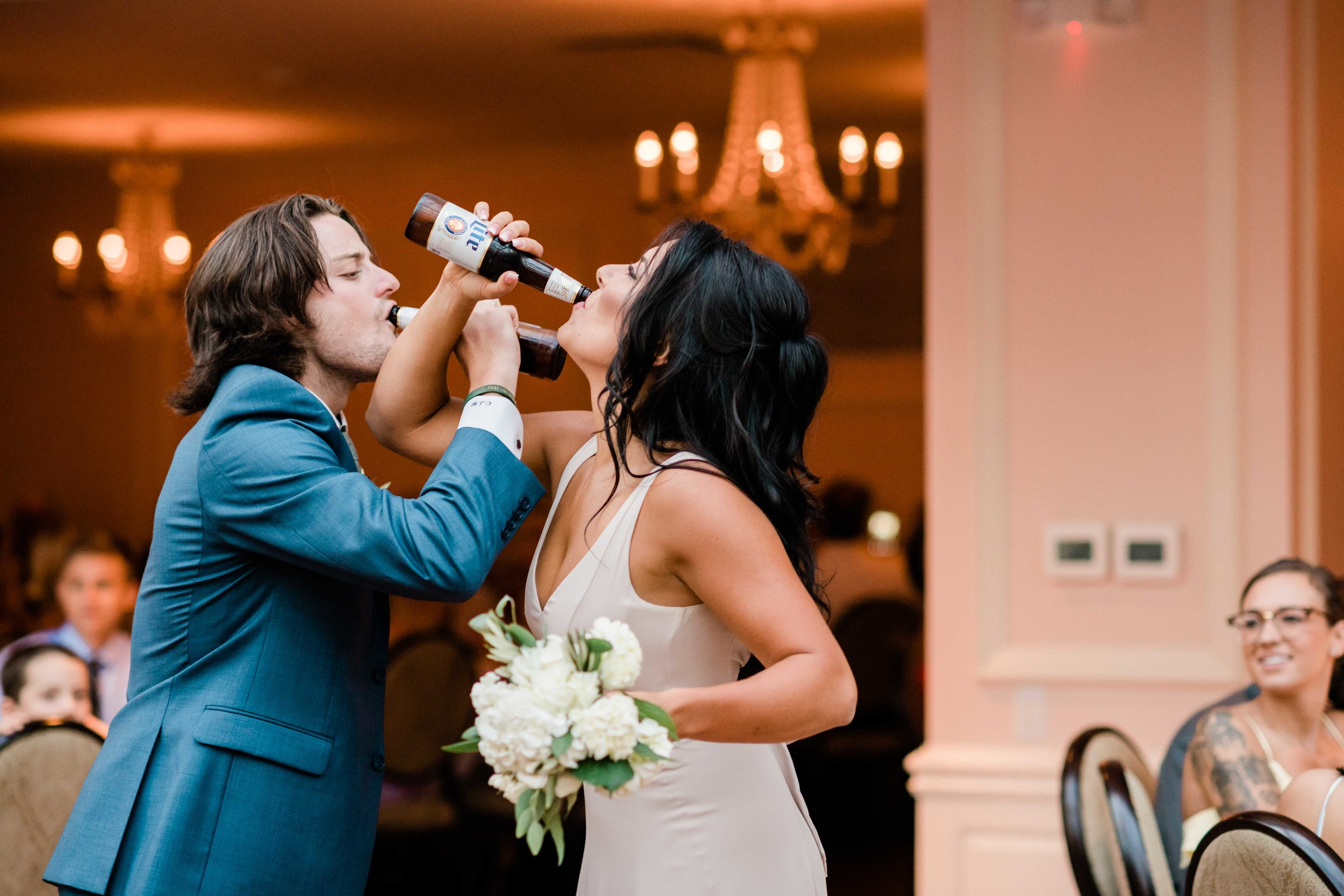 Groomsmen and bridesmaid chug beer during grand entrance