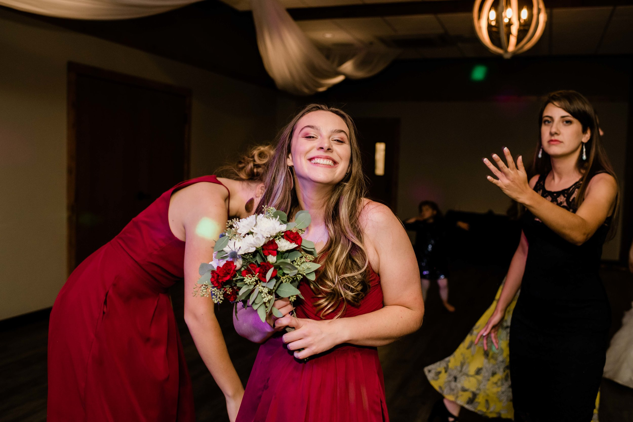 Bridesmaid catches bouquet
