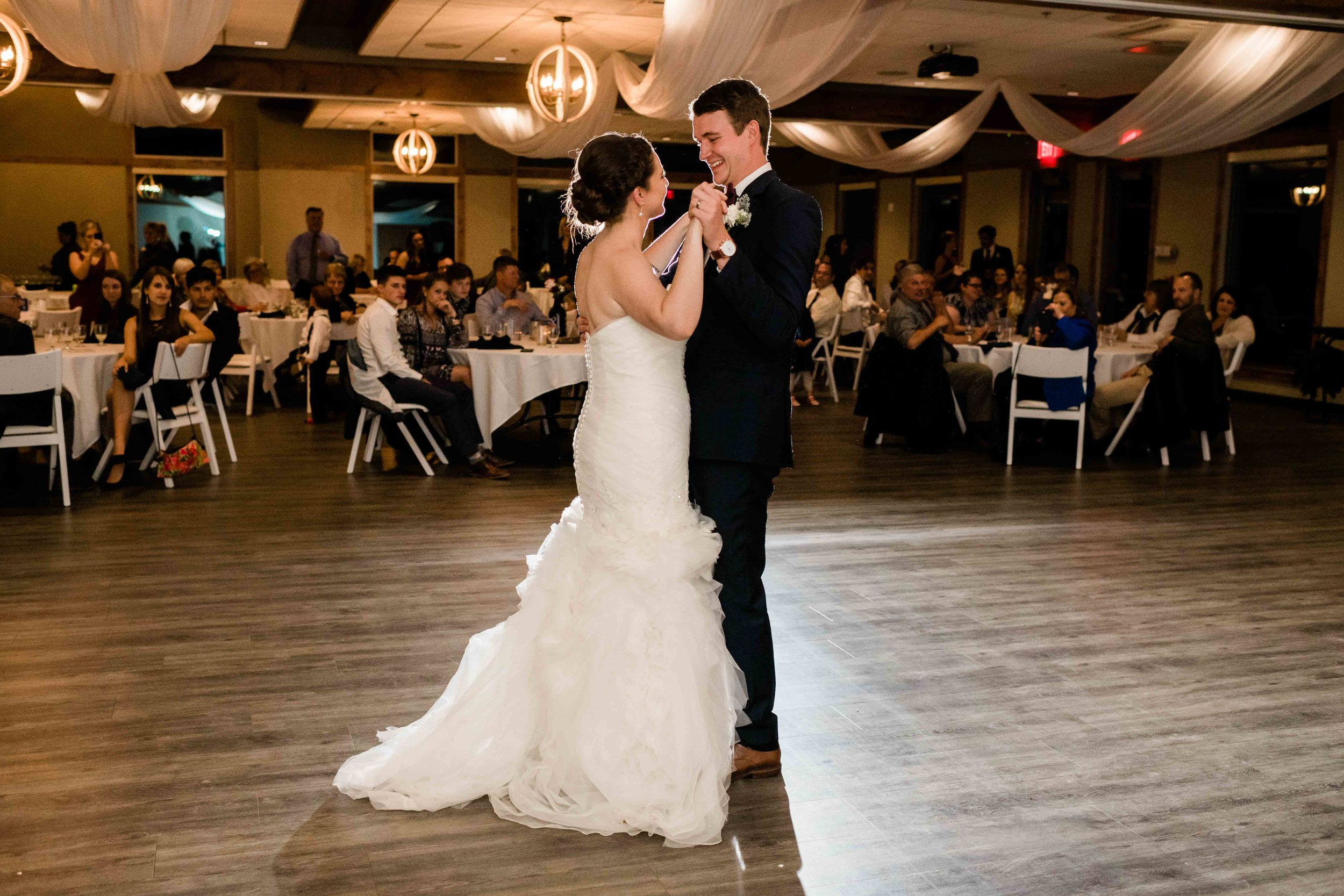 Bride and groom share their first dance as a married couple