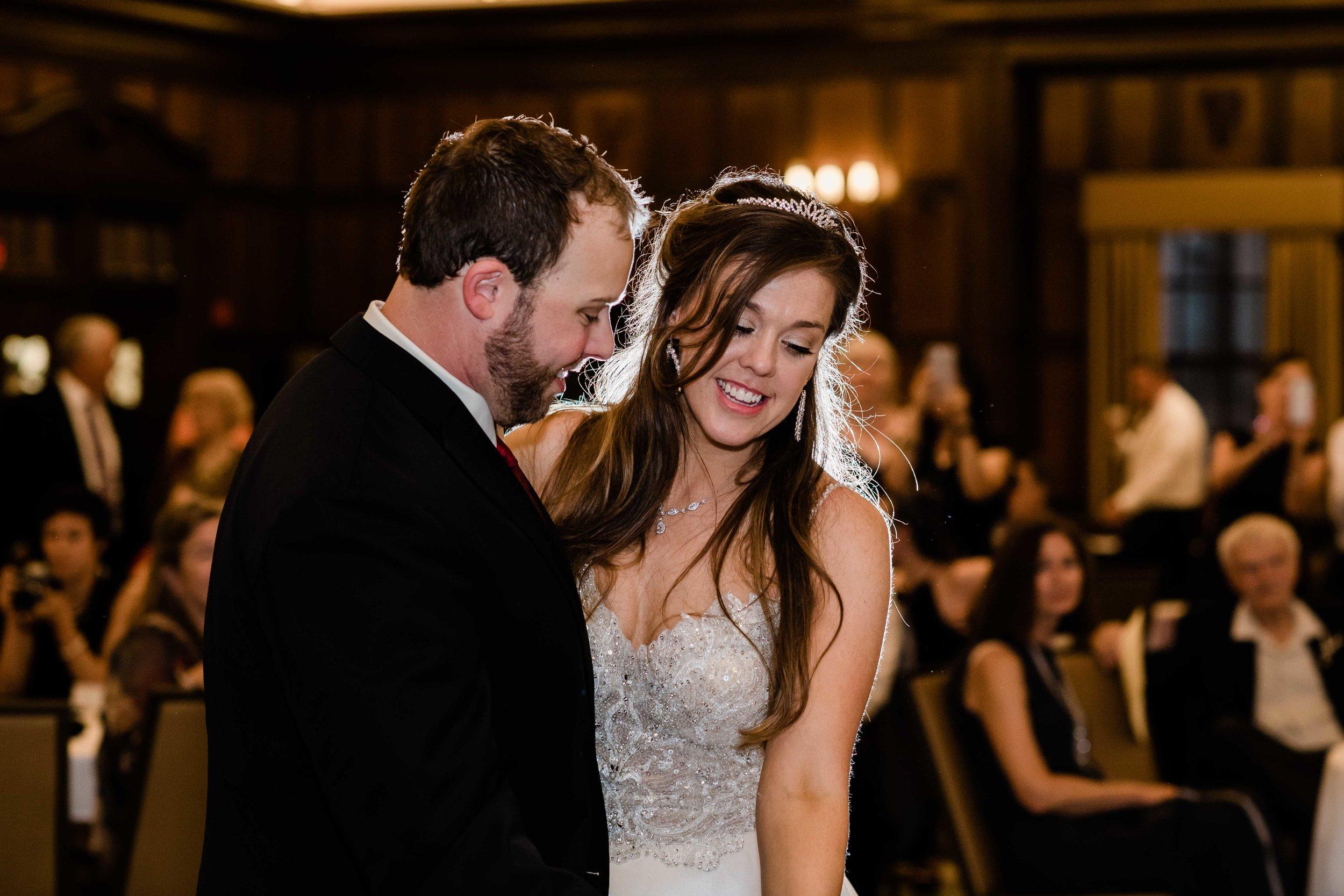 Backlit bride and groom dancing