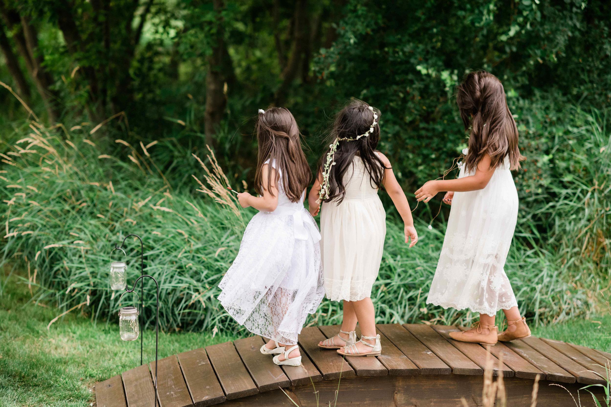 Flower girls playing on a bridge