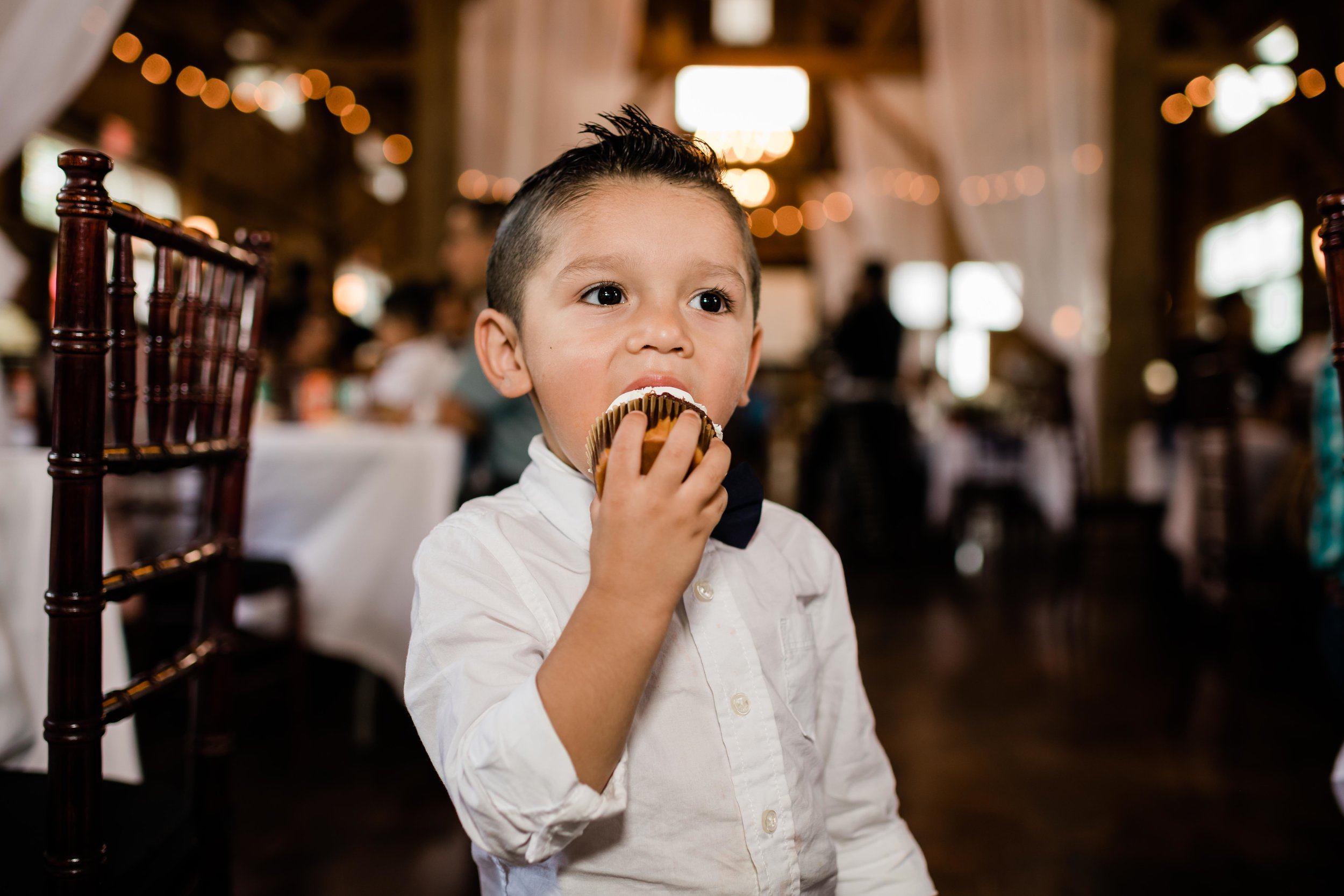 Child eating wedding cupcake
