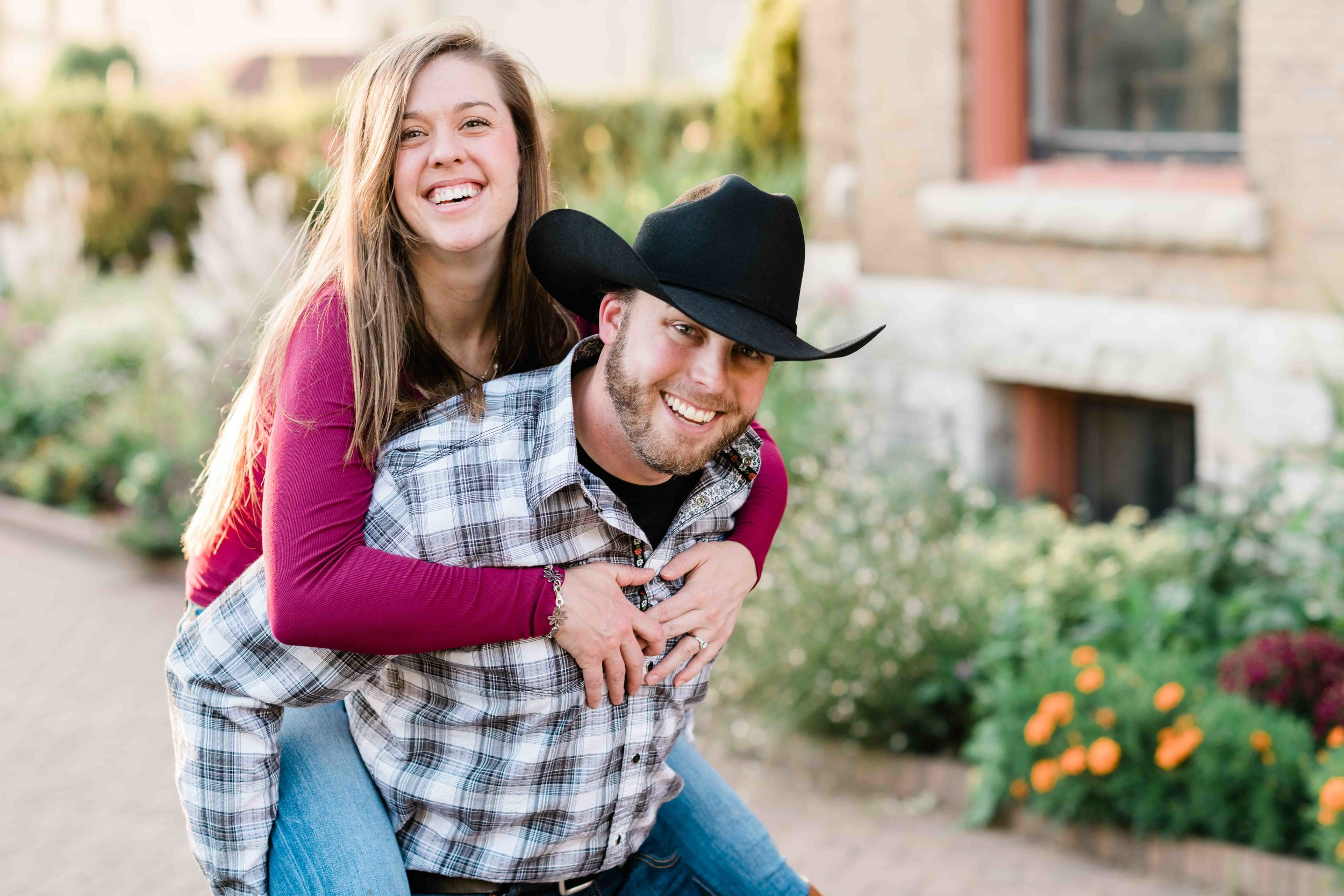 Man gives his fiancé a piggy back ride