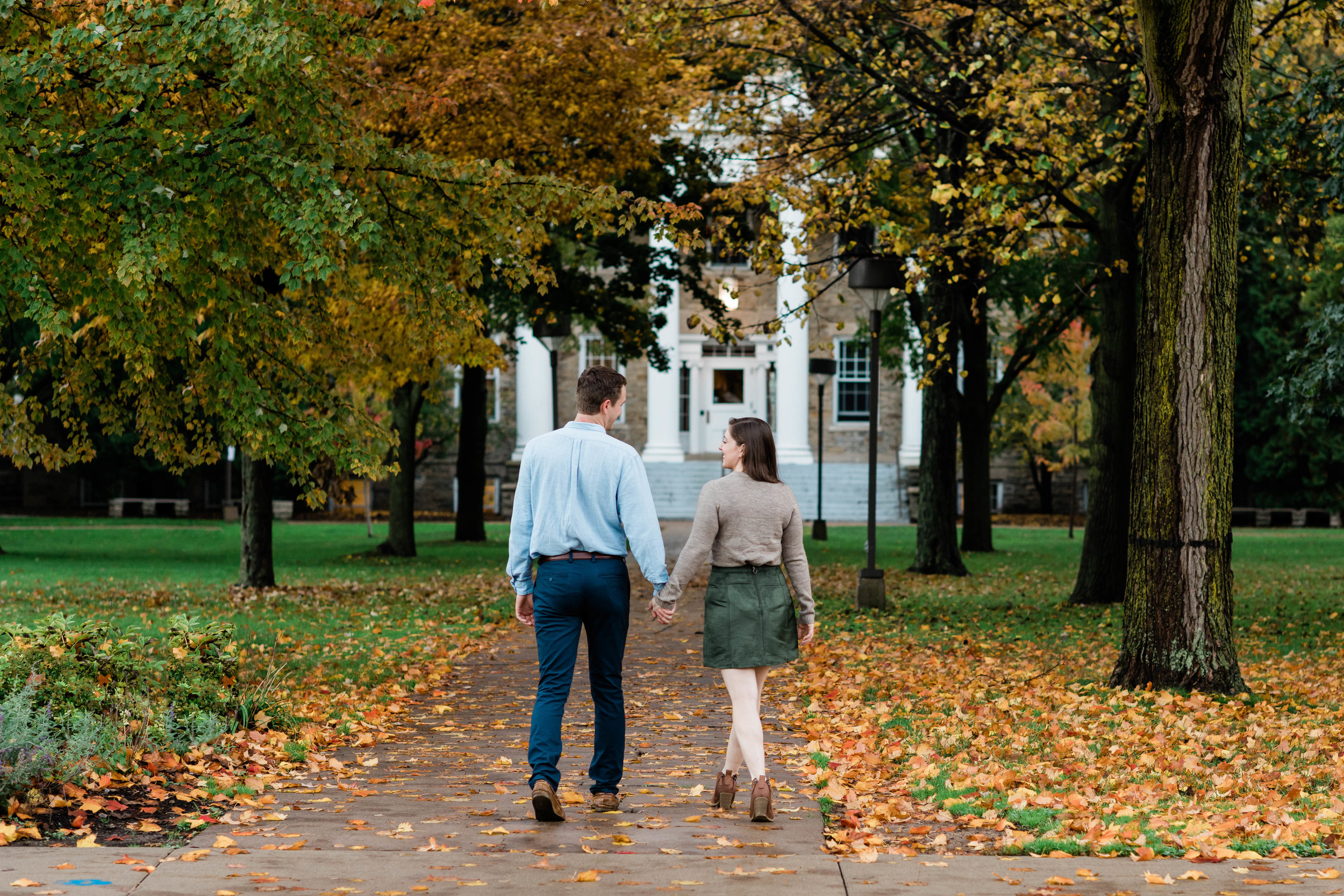 Engaged couple walking in the fall