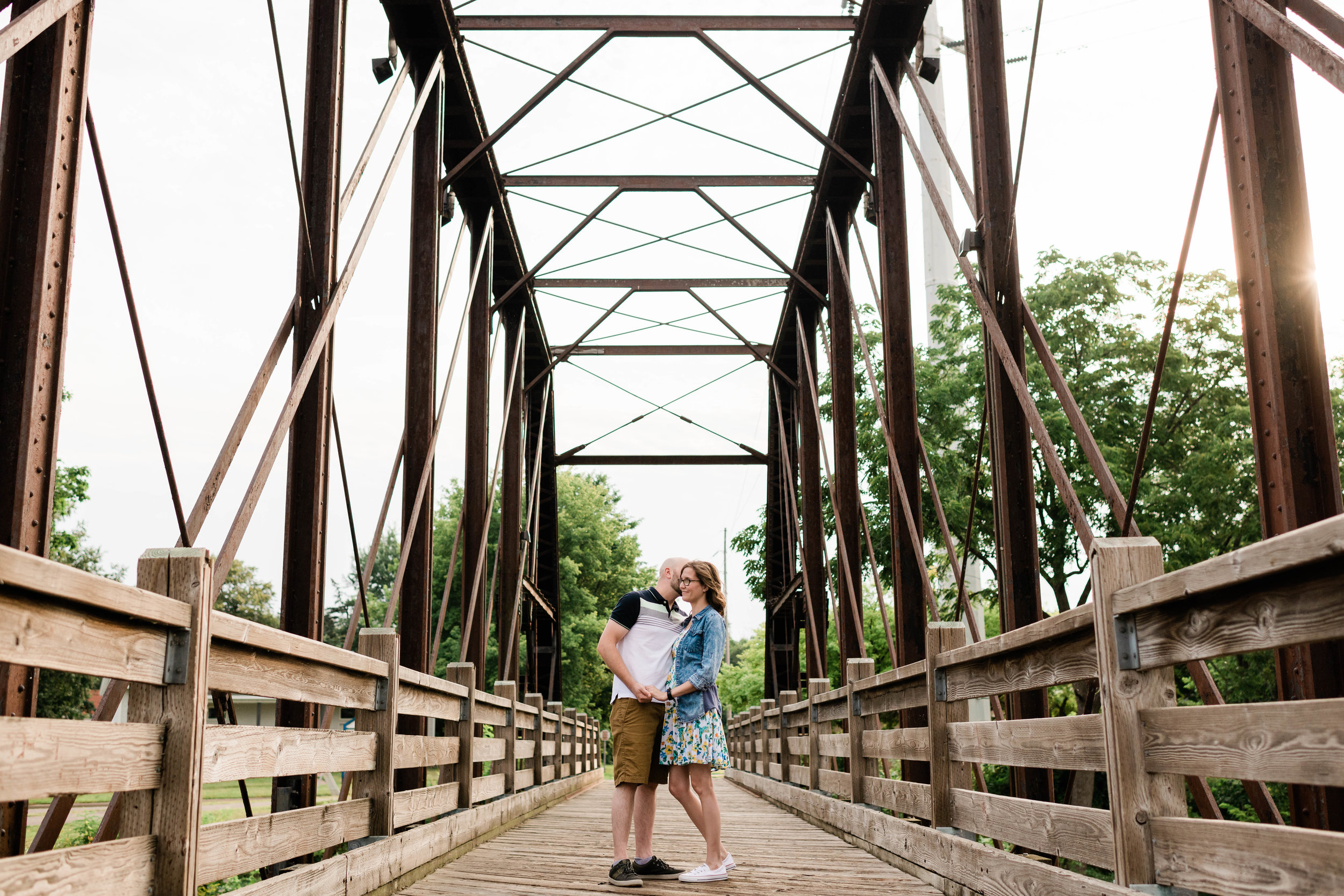 Engaged couple on a bridge