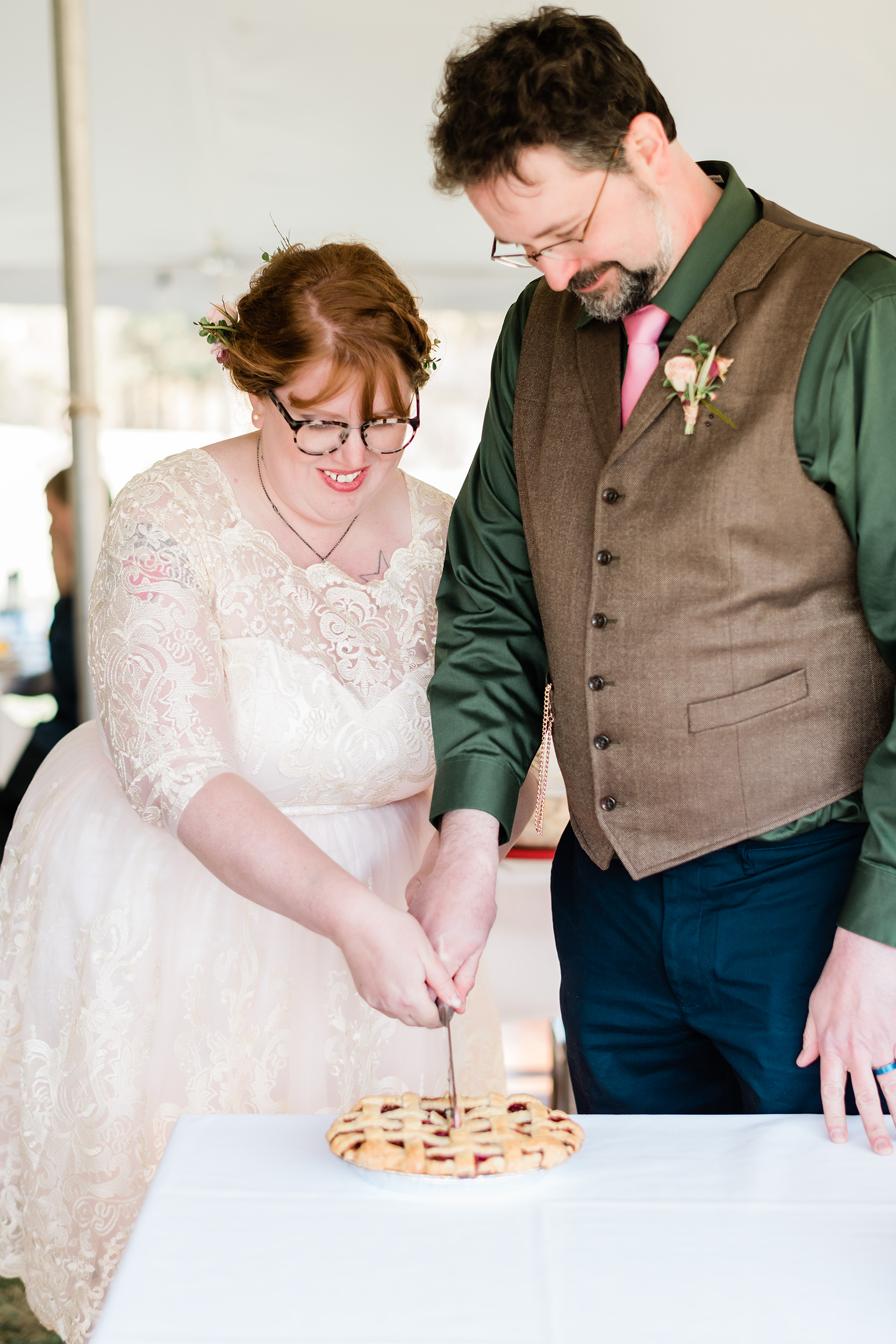 Bride and groom cutting pie