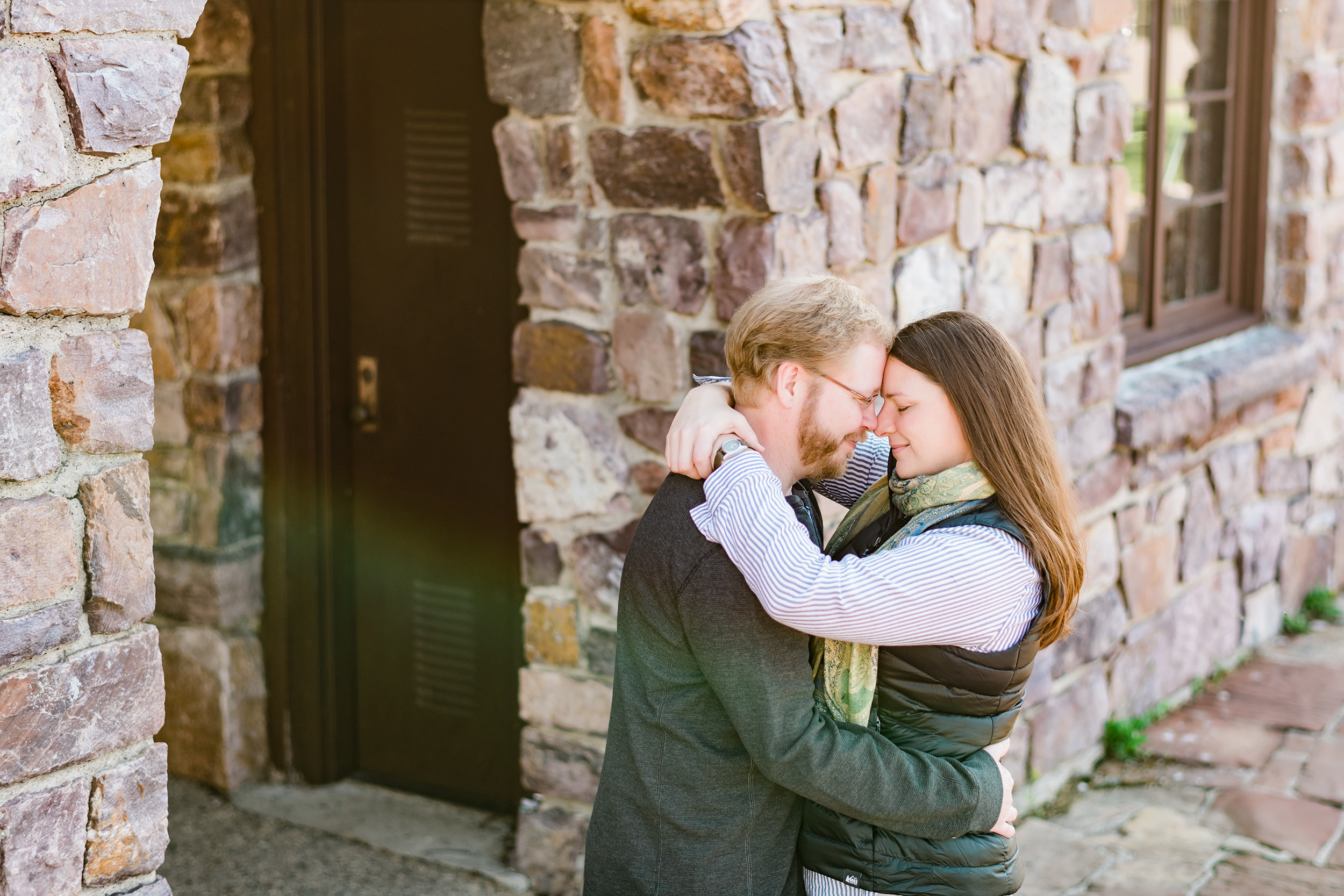 Engaged couple forehead to forehead at Devil's Lake State Park