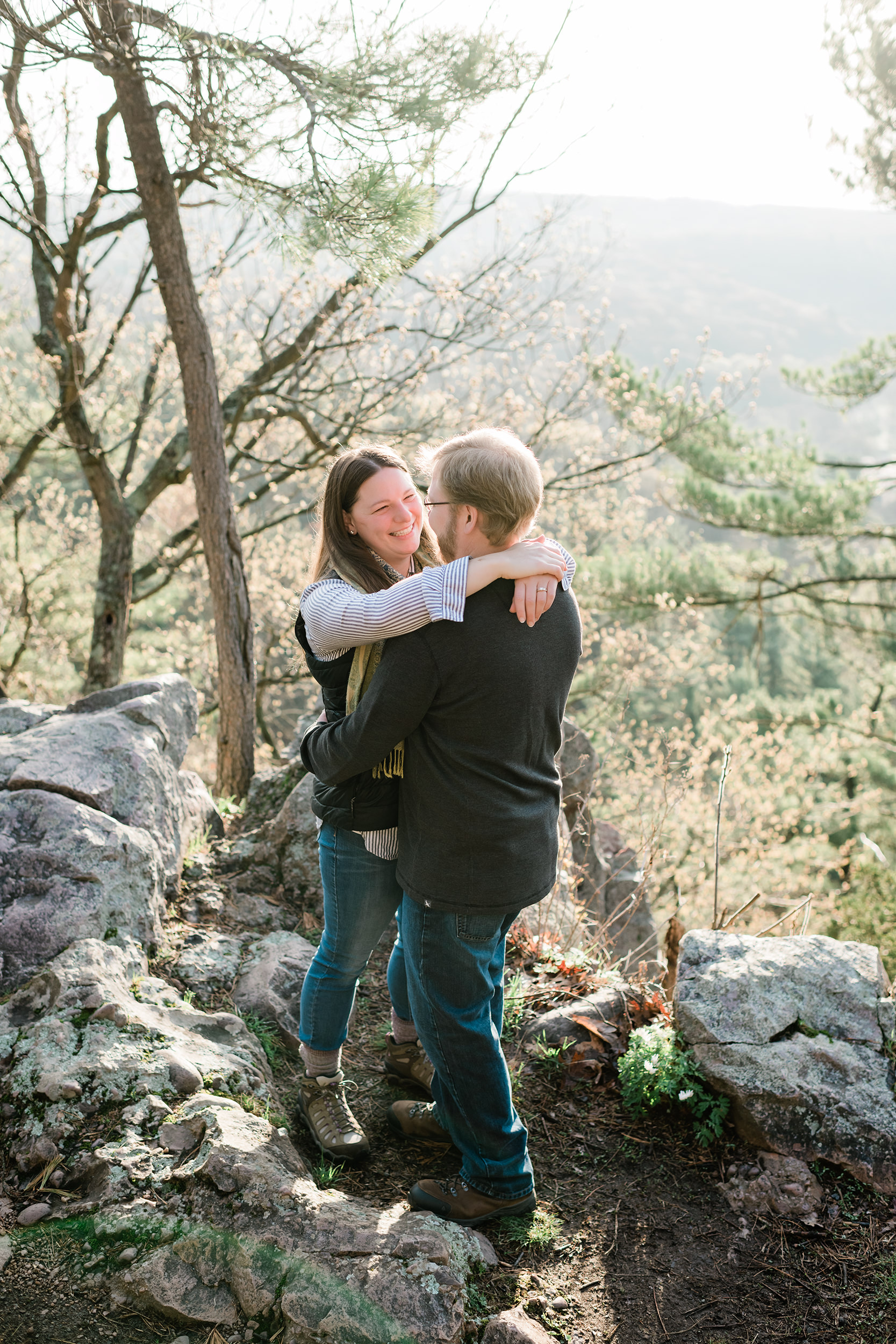 Woman wraps arms around fiancé