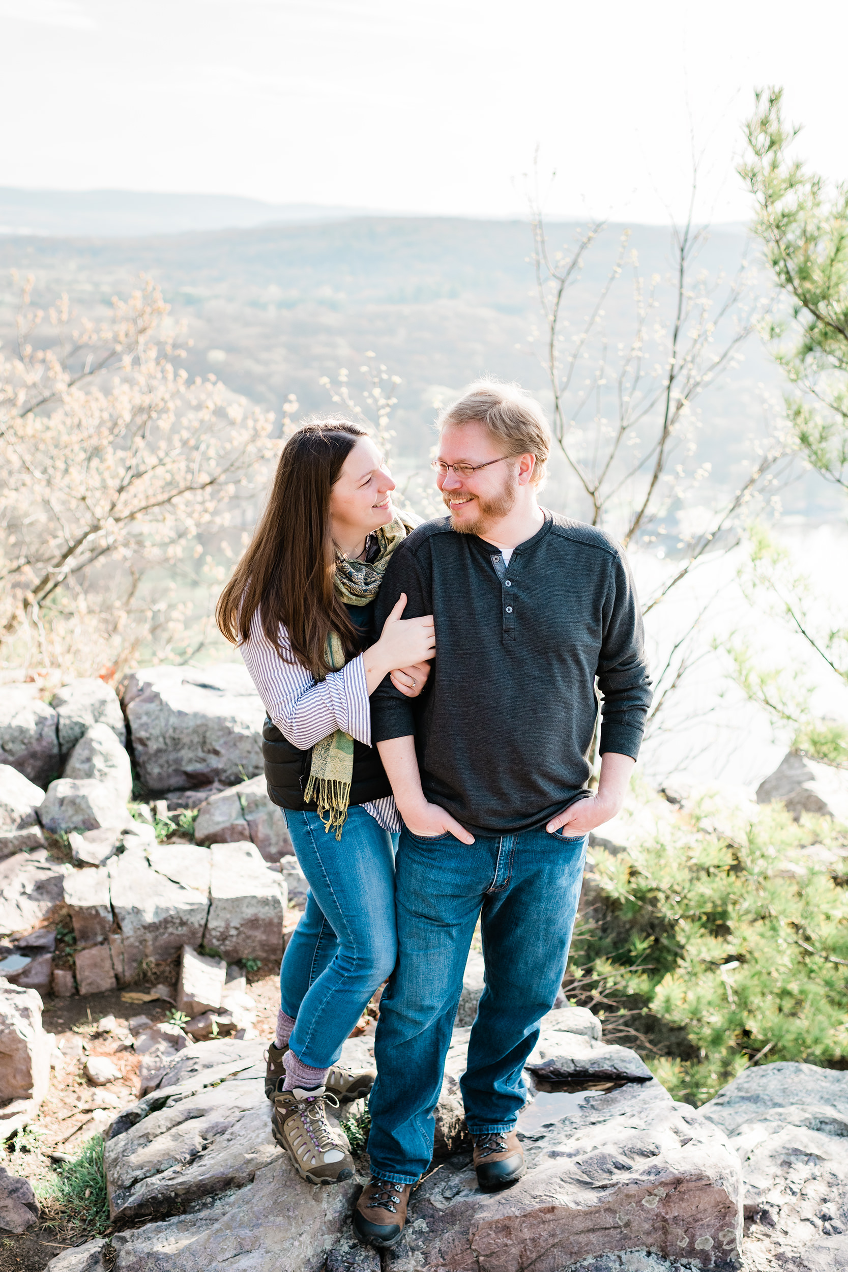 Engaged couple standing on rocks at Devil's Lake State Park