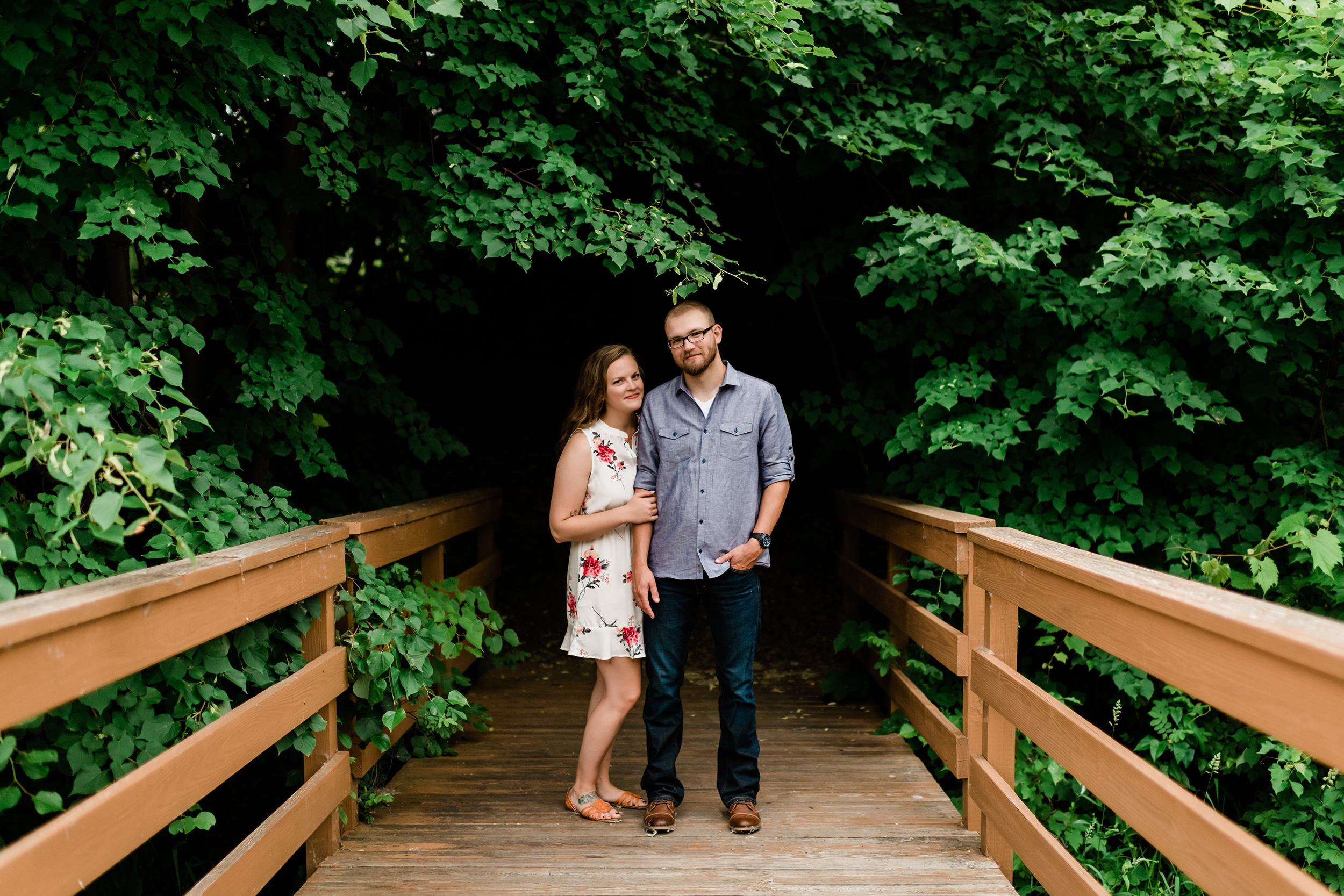 Engaged couple on a bridge