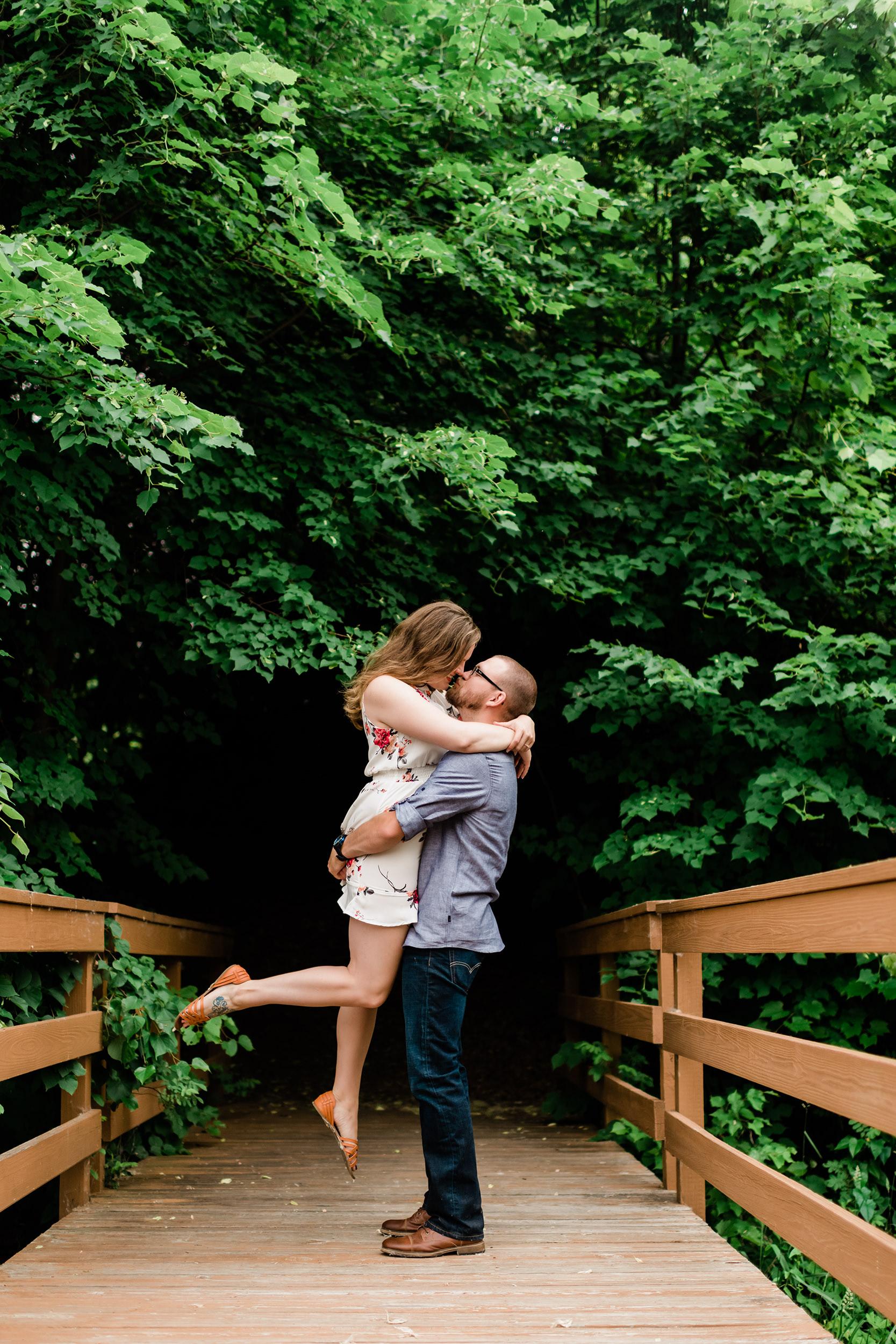 Man picks up his fiancé as she kisses him