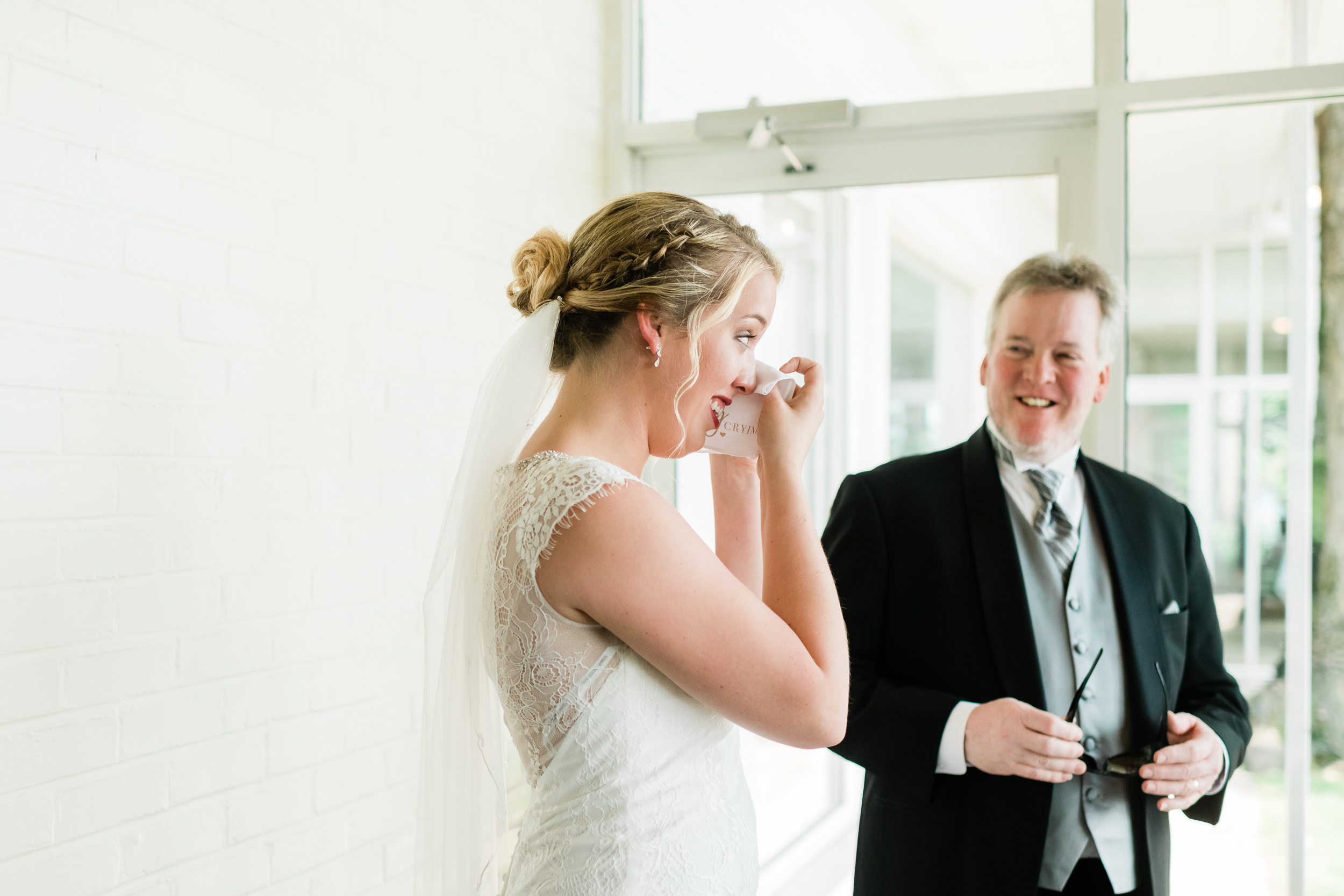 Bride wipes away tears during first look with her dad