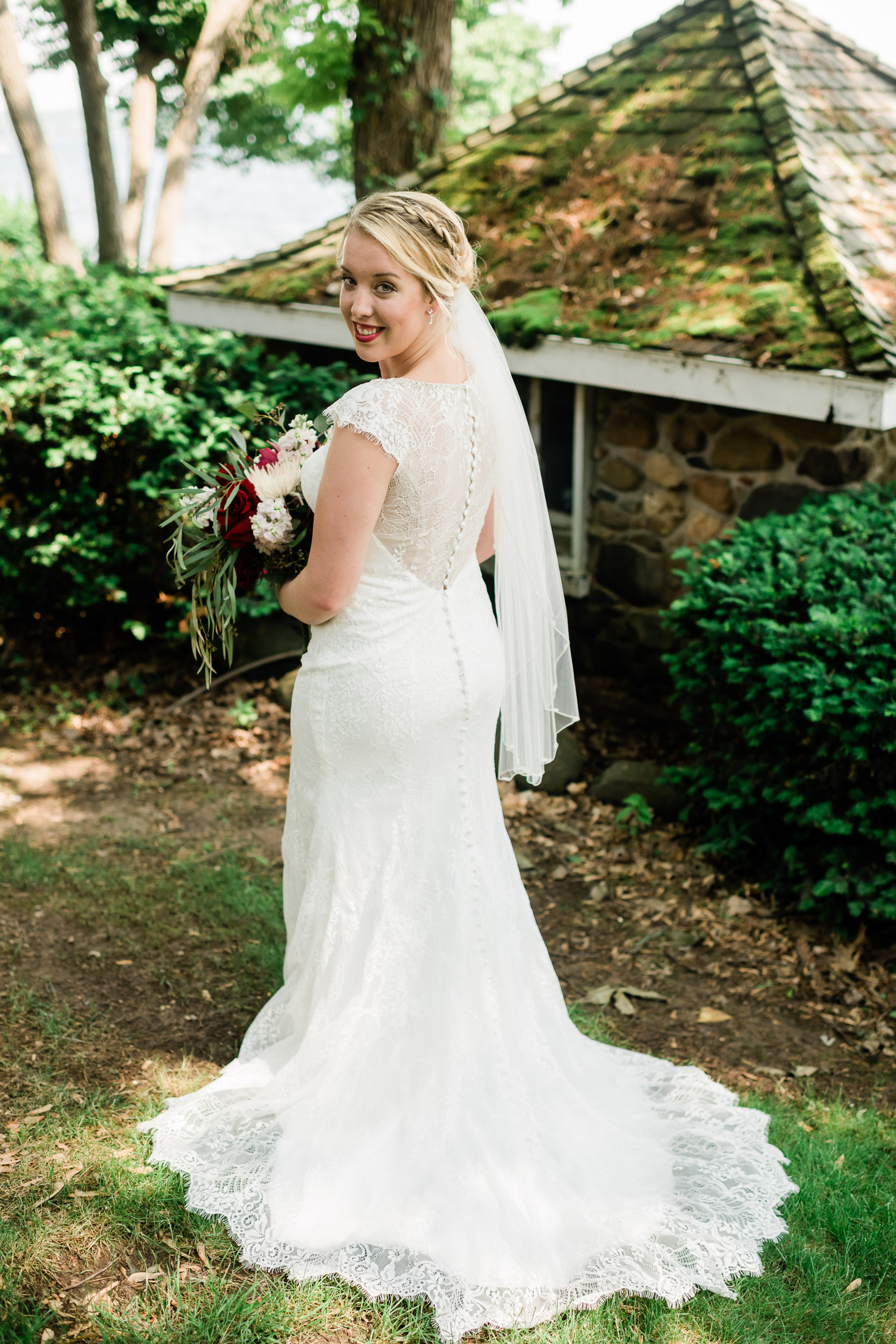 Bride showing off the back of her wedding dress