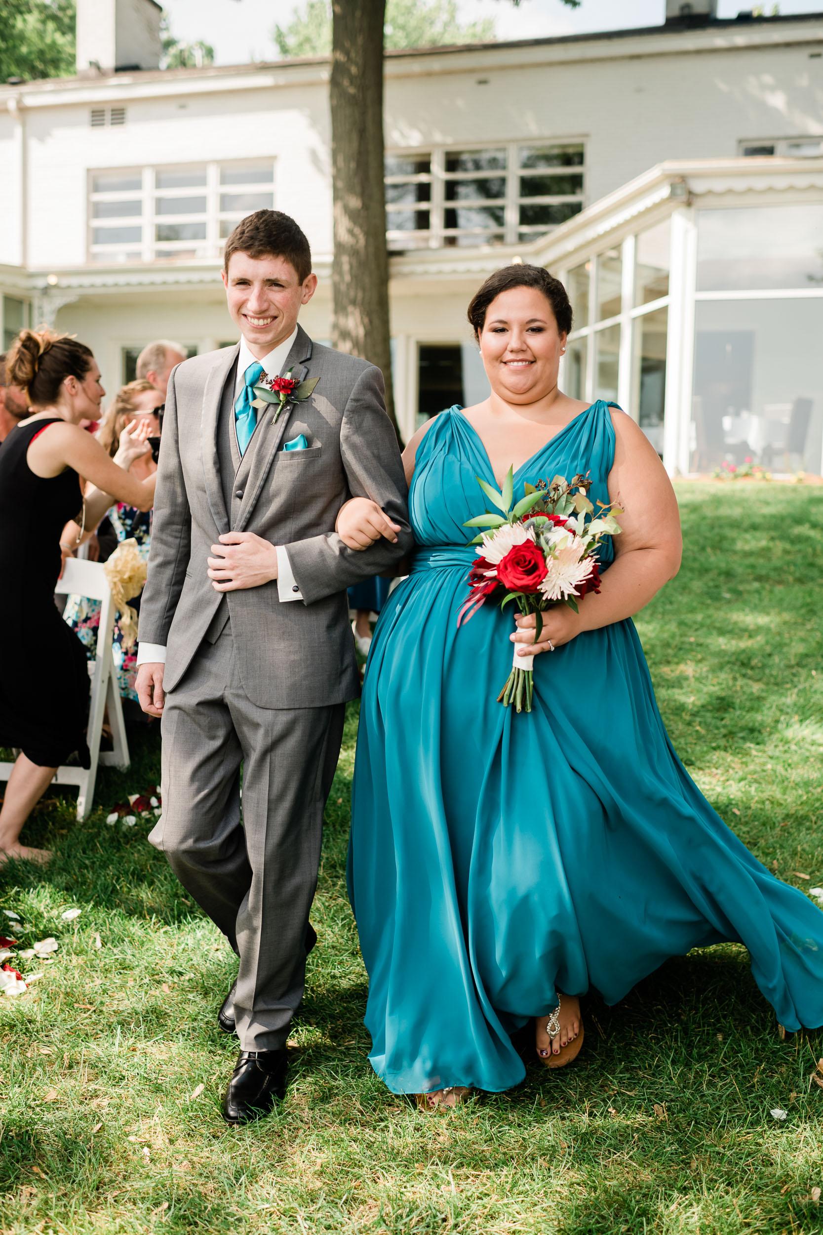 Groomsman and bridesmaid walking down the aisle