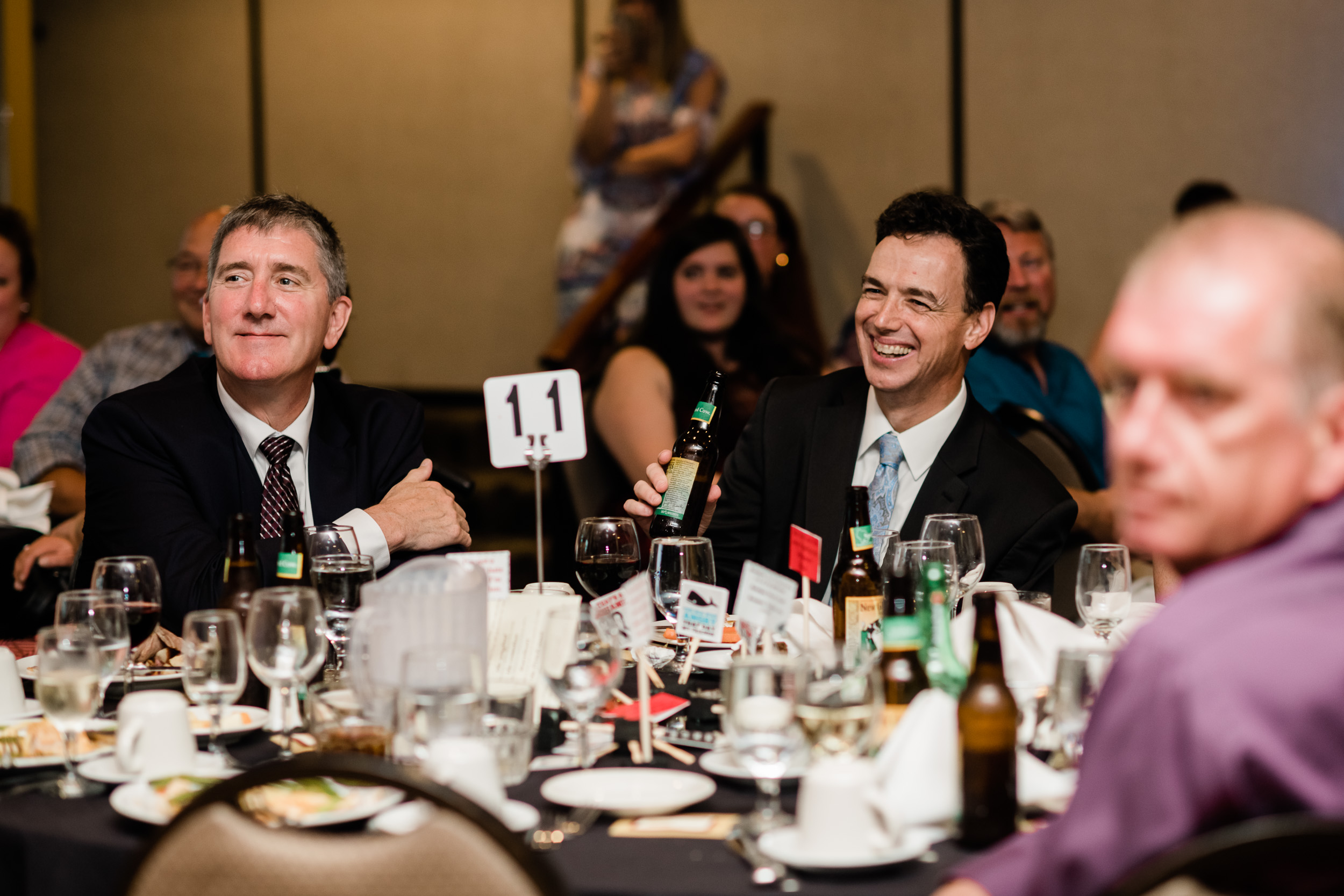 Wedding guests laughing during dinner