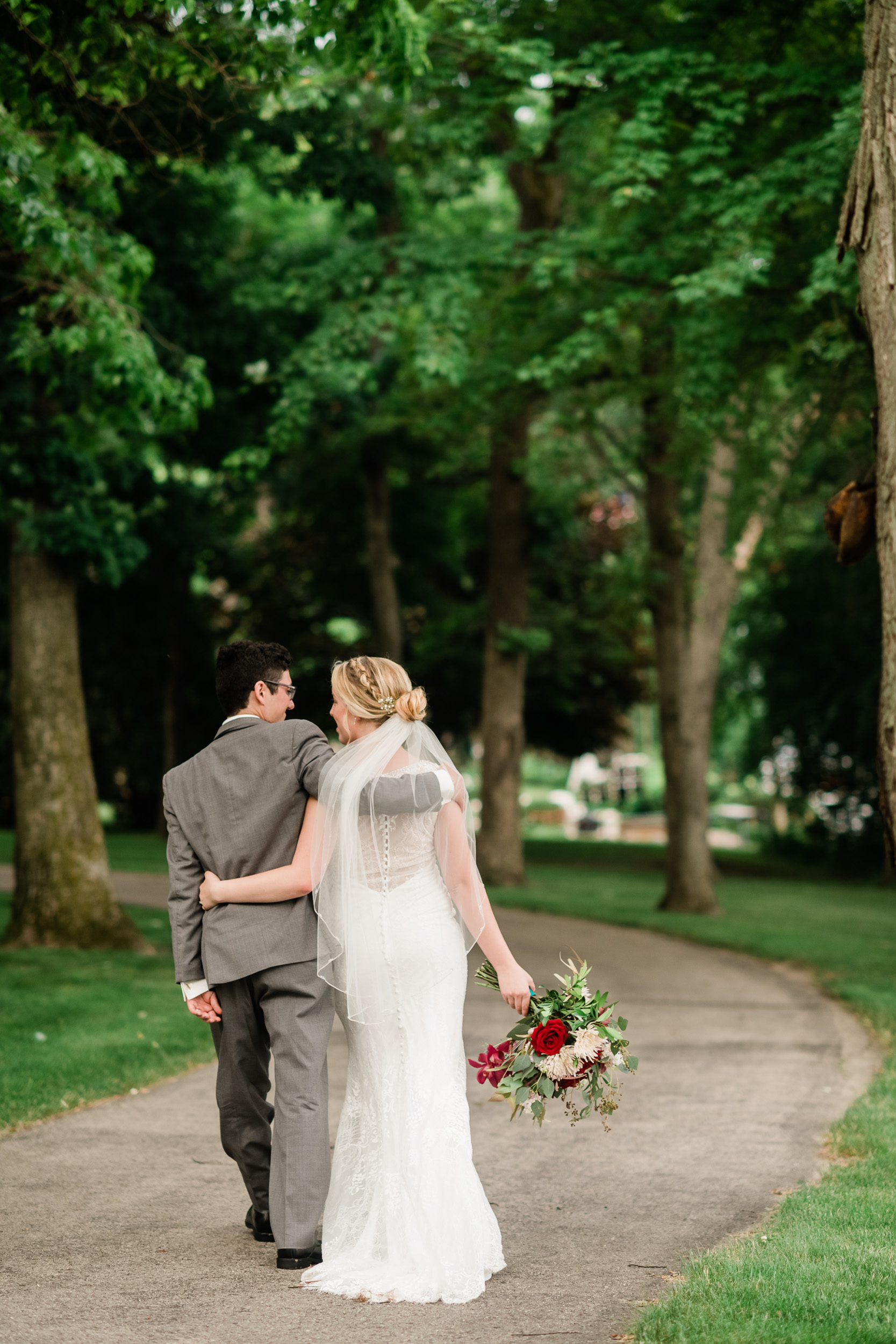 Bride and groom walking on a path