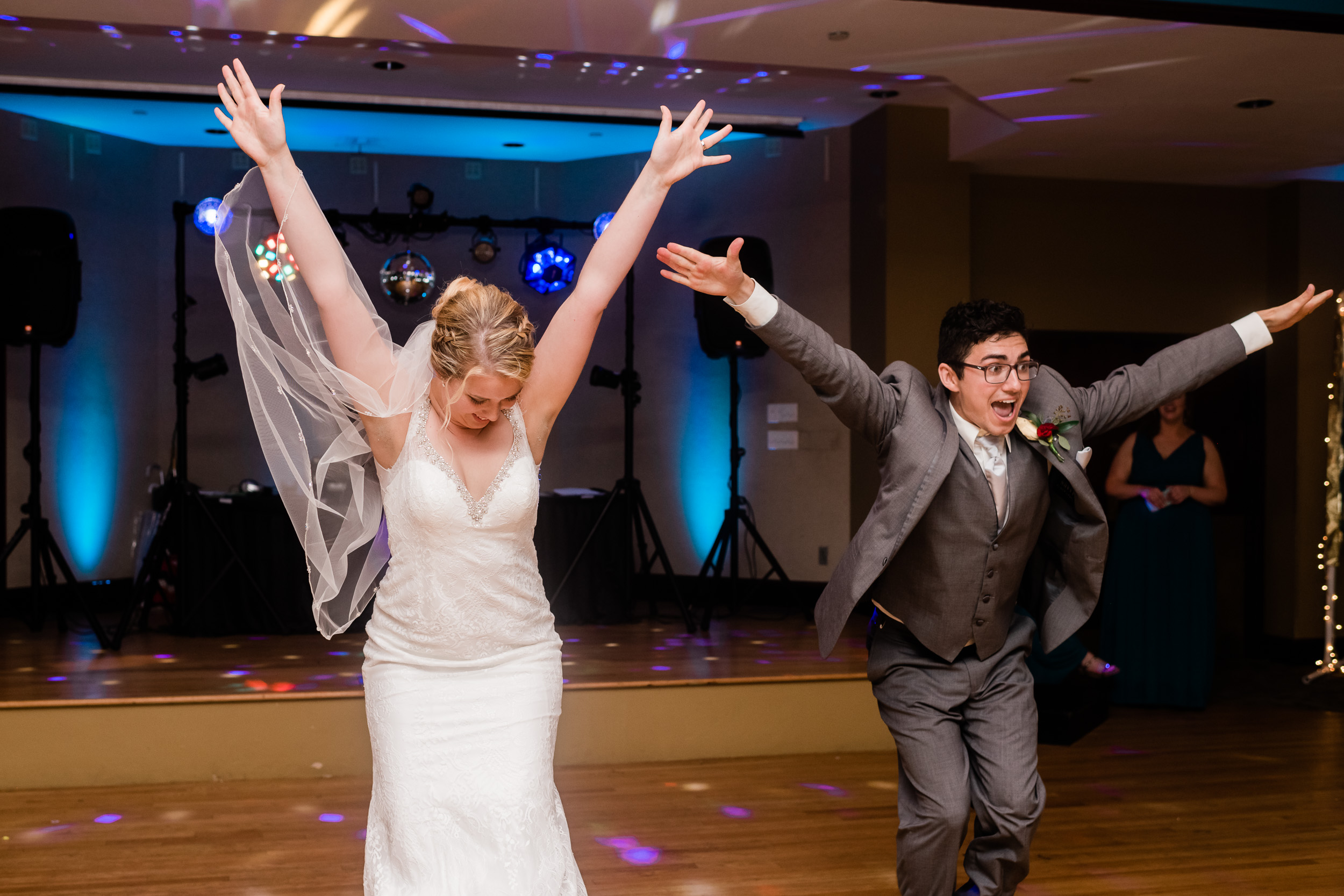 Bride and groom with hands in the air