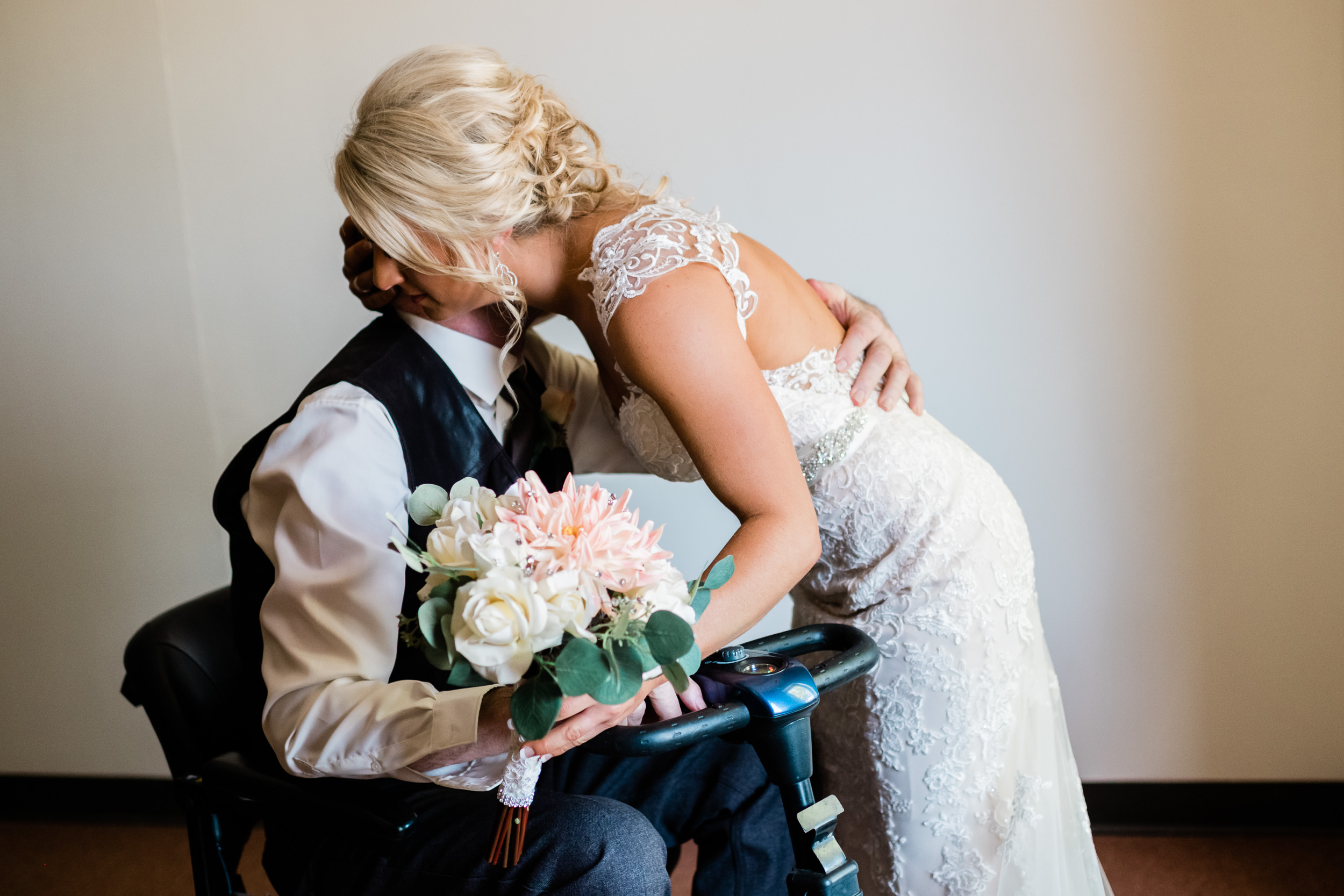 Bride hugging her wheelchair bound father