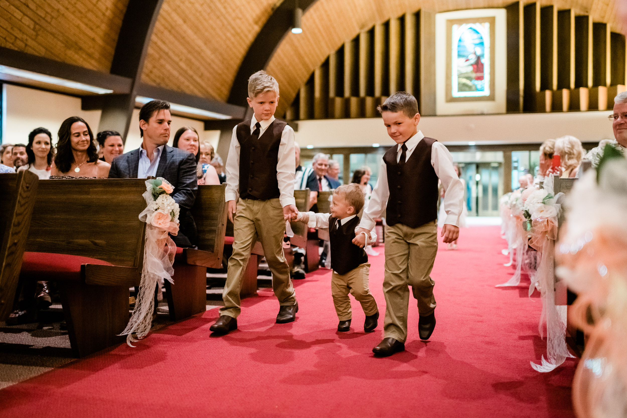 Ring bearers walking down church aisle
