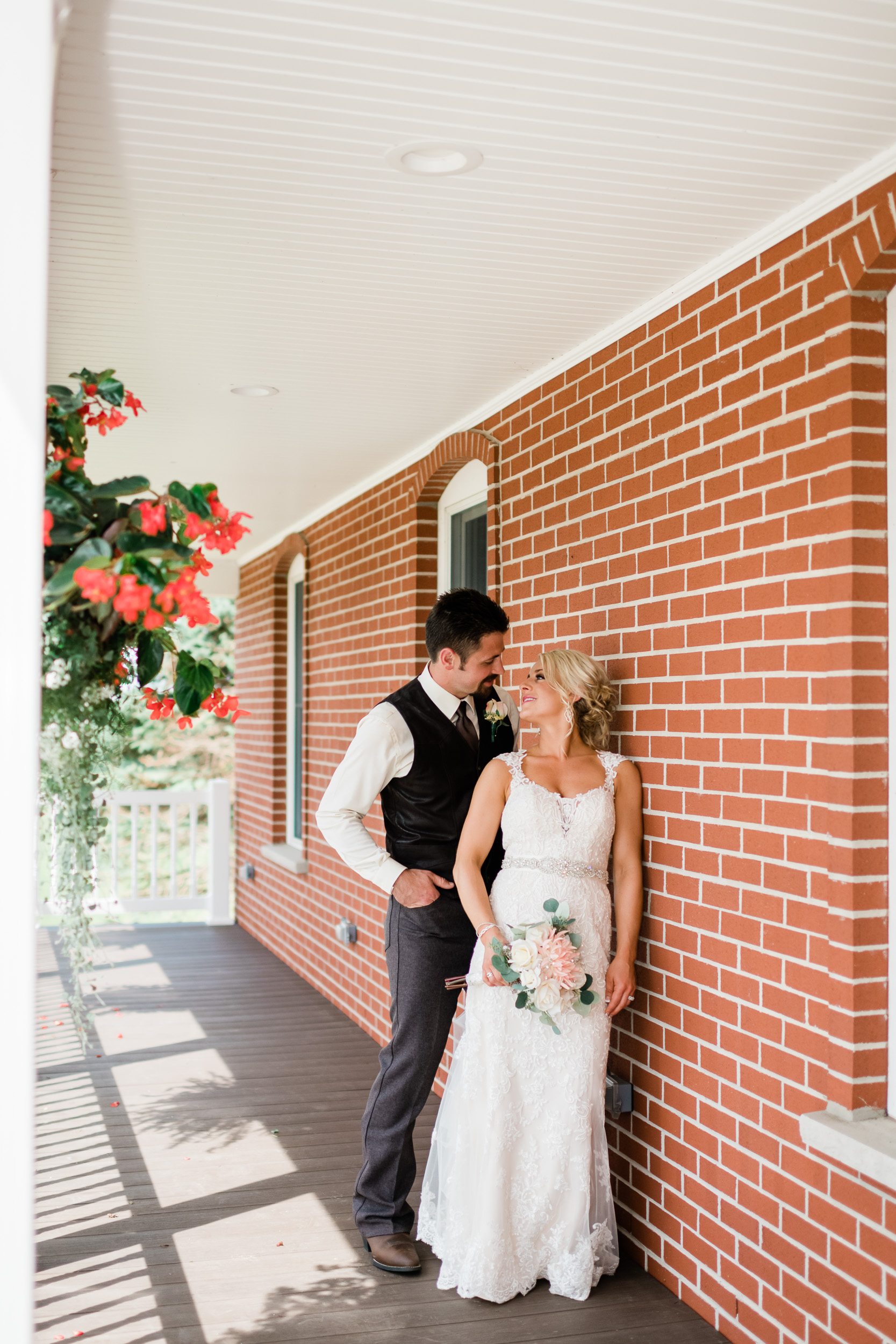 Bride and groom on their front porch