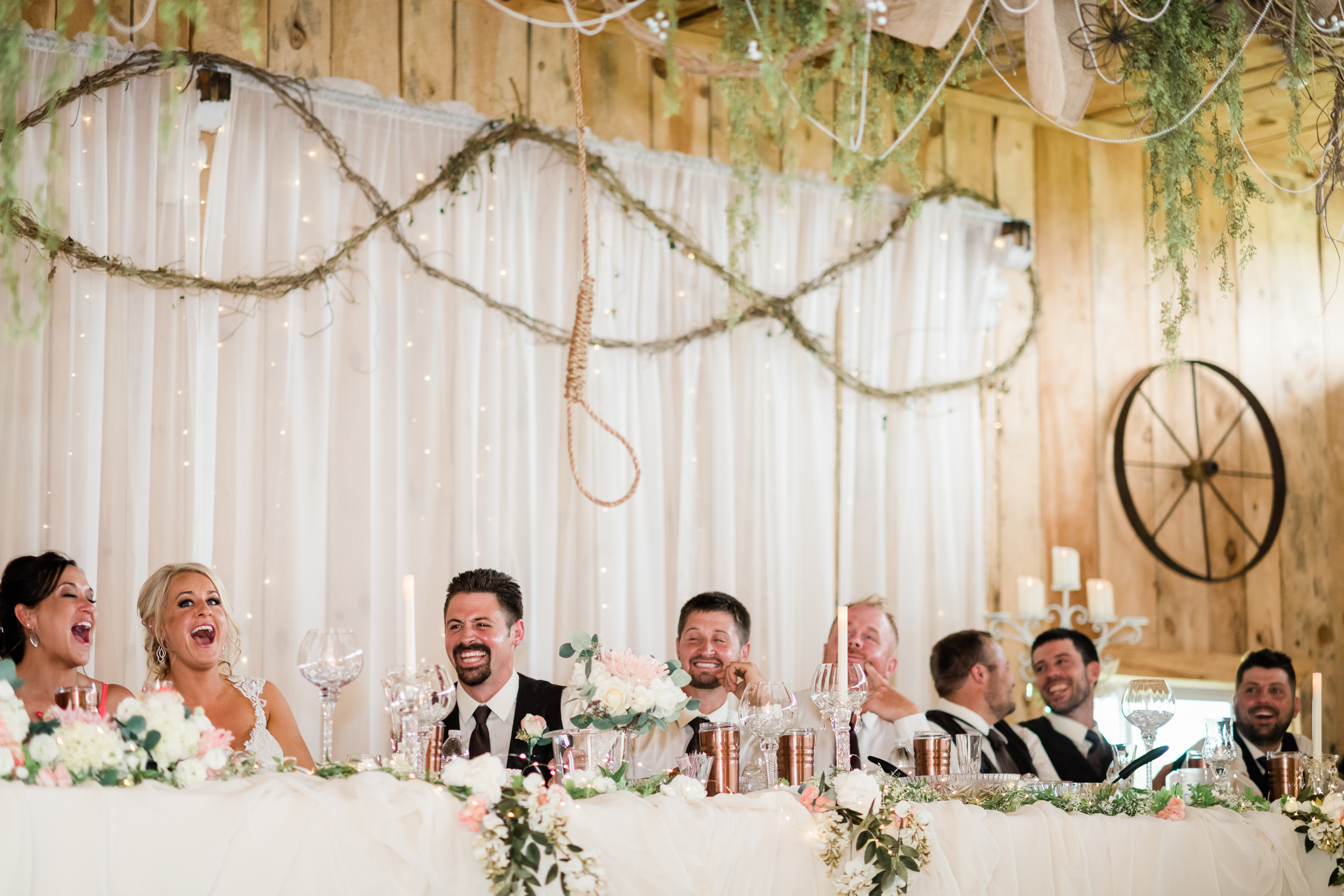 Head table laughing at noose hanging from the ceiling