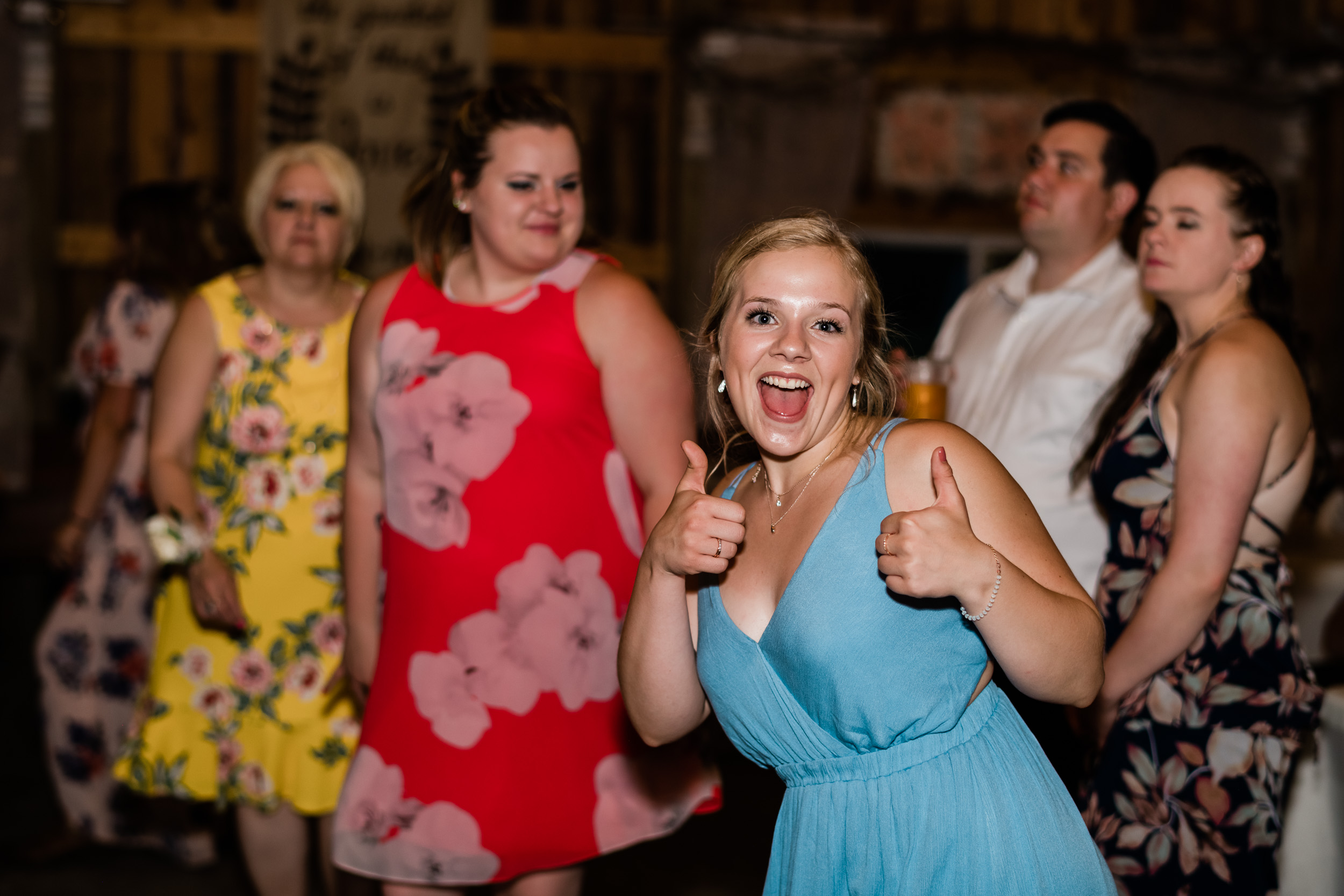 Wedding guest with thumbs up