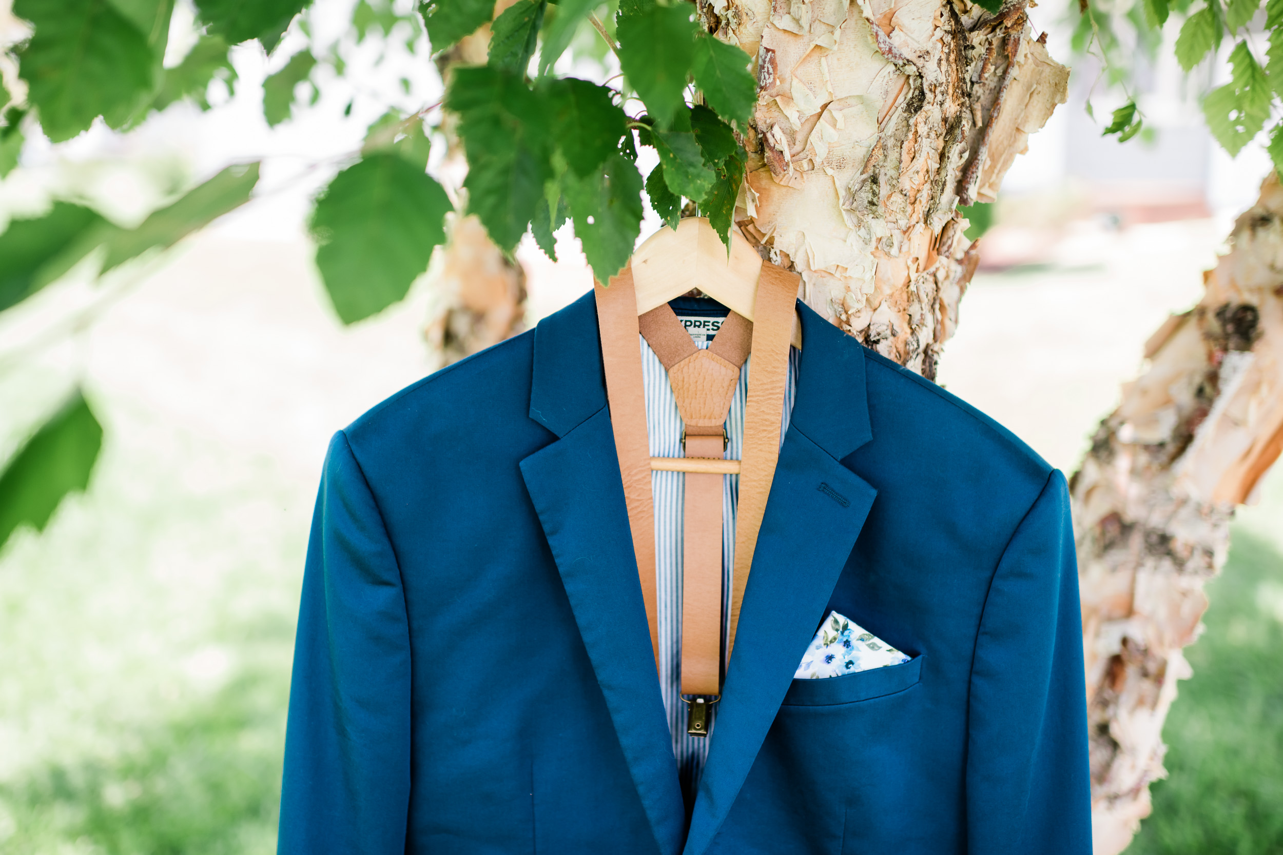 Groom's jacket hanging in a tree