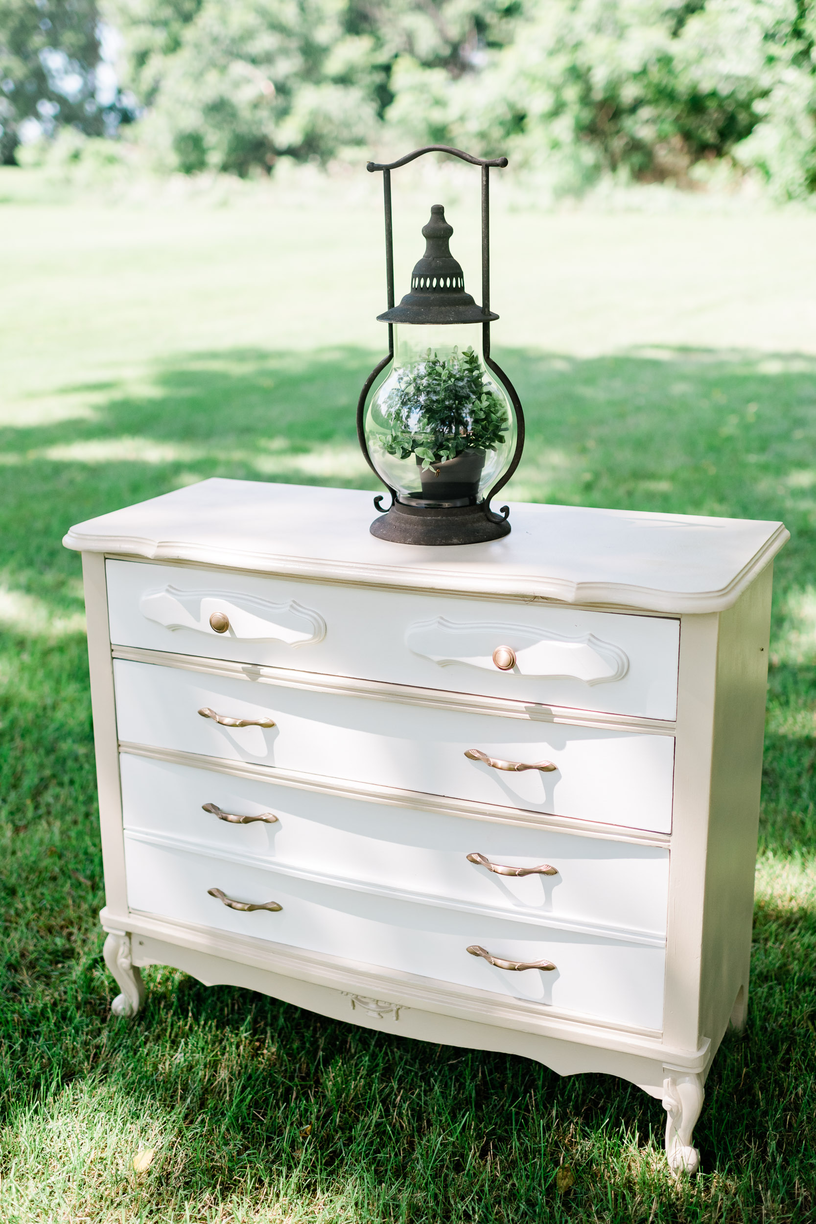 Dresser with a lantern on top