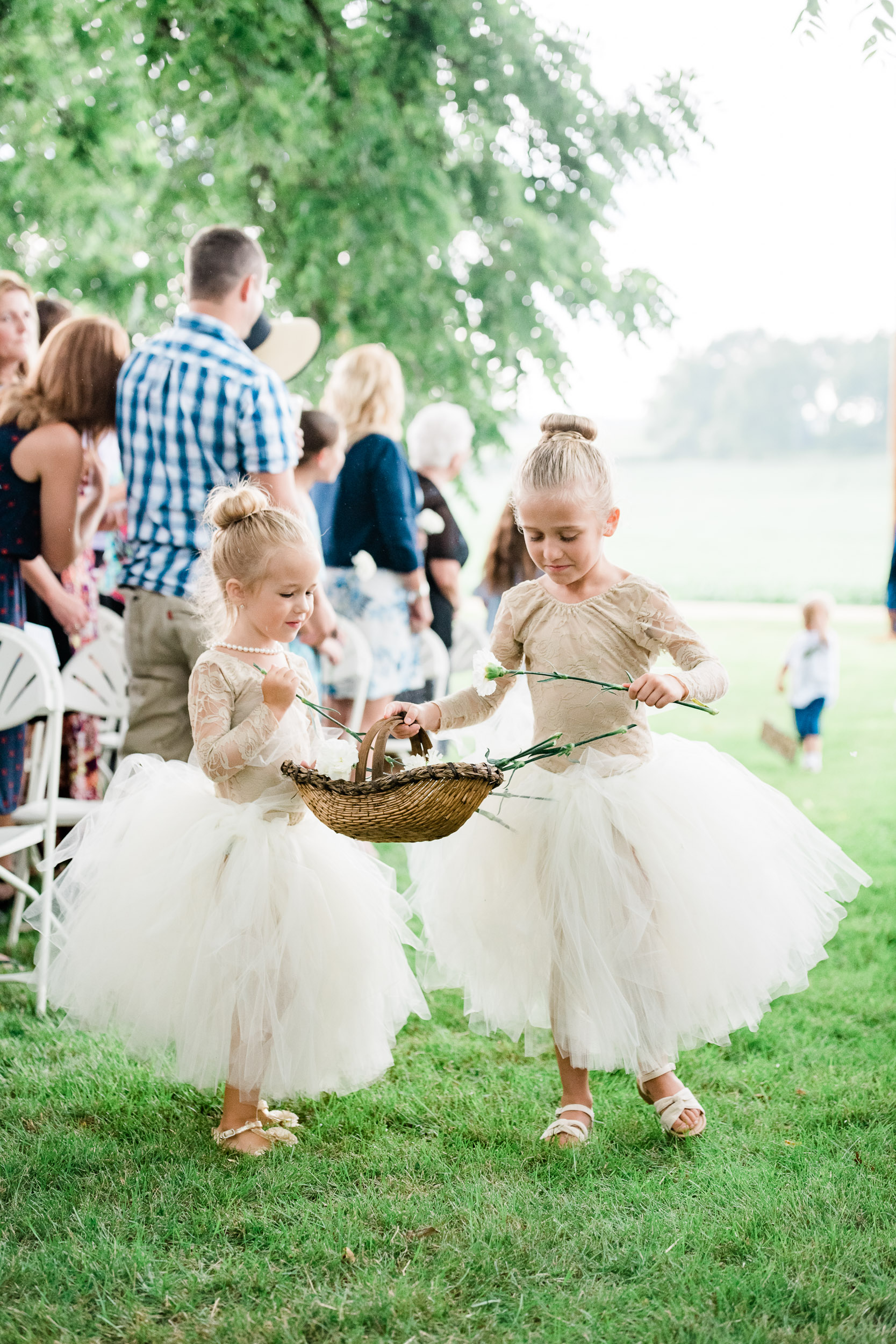 Flower girls putting petals out
