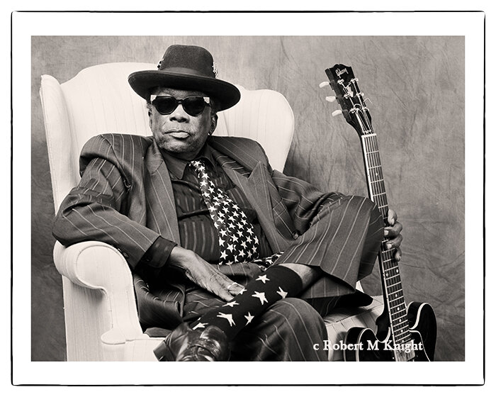 """""""Star Socks""""   Robert Knight Image of John Lee Hooker 1995 Hollywood, CA Photograph 30 x 40 inches Edition of 99     INQUIRE"""
