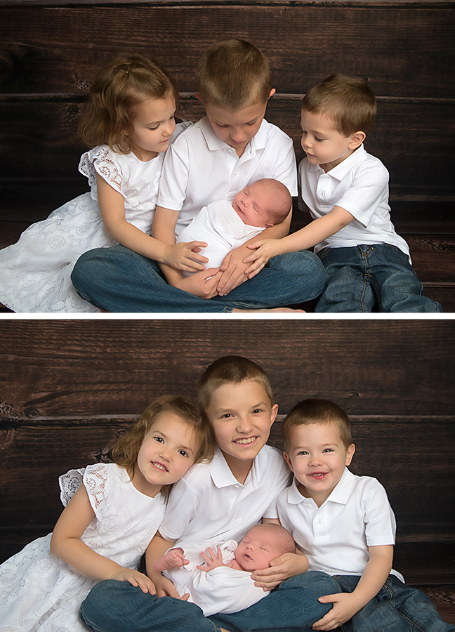 st-louis-newborn-photographer-three-older-siblings-holding-newborn-wearing-white-on-wood-backdrop.jpg