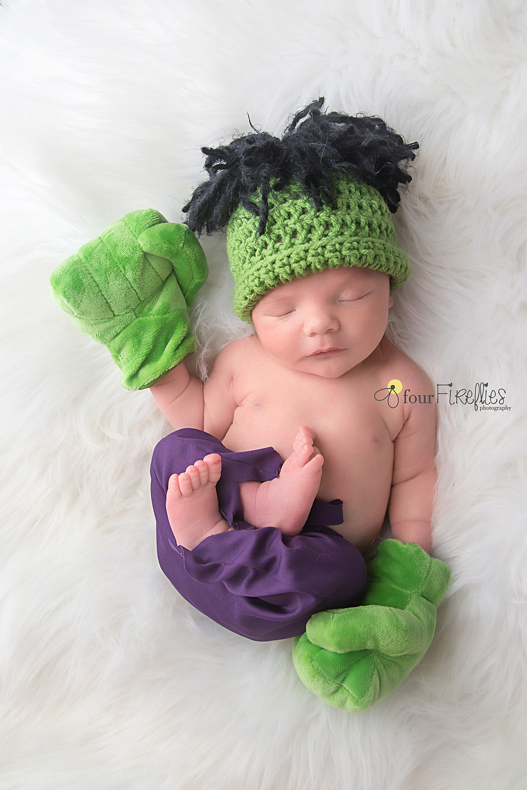 st-louis-newborn-photographer-baby-boy-in-hulk-costume-with-hands-and-purple-pants.jpg