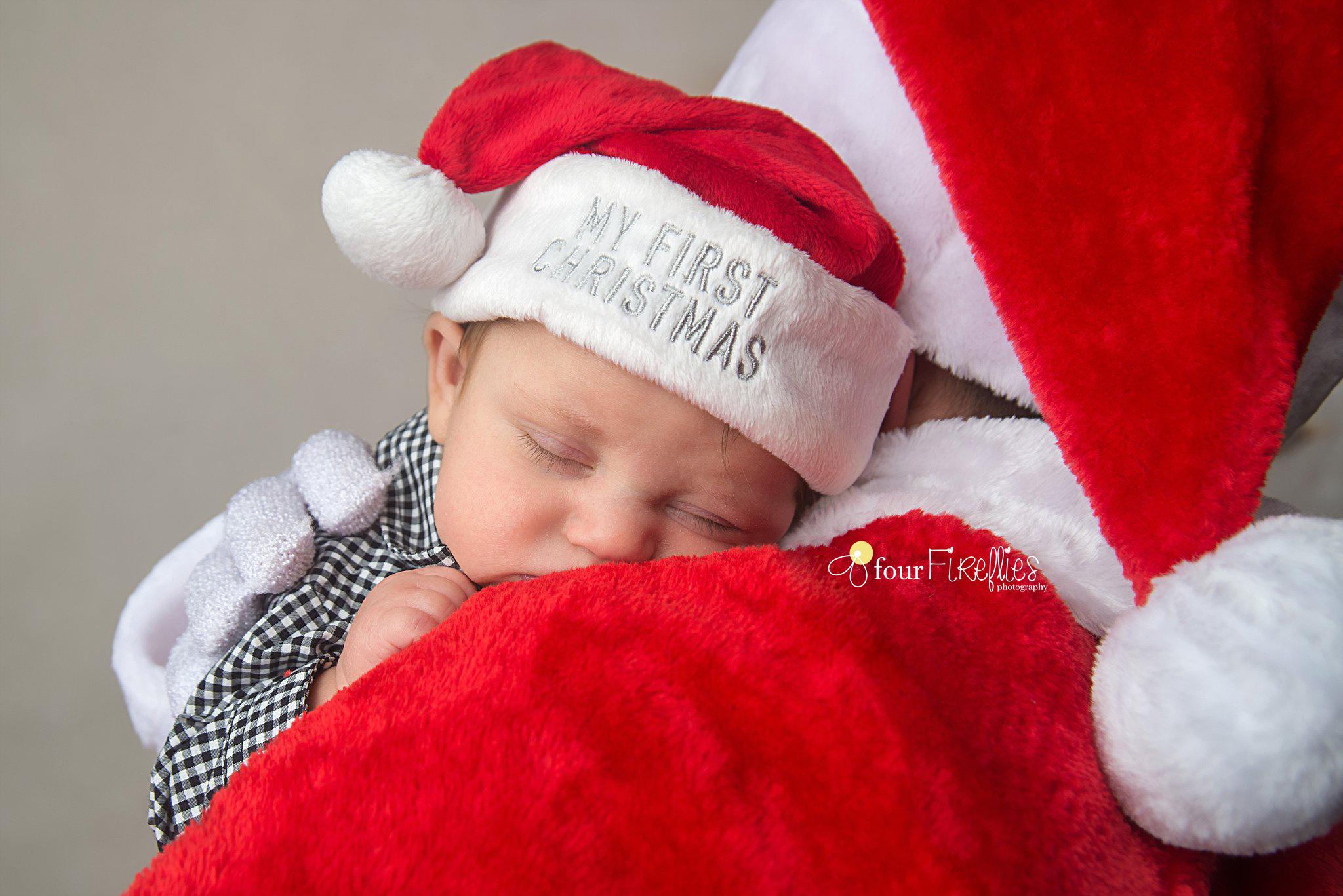 st-louis-newborn-photographer-christmas-baby-baby-in-first-christmas-hat-sleeping-on-santas-shoulder.jpg