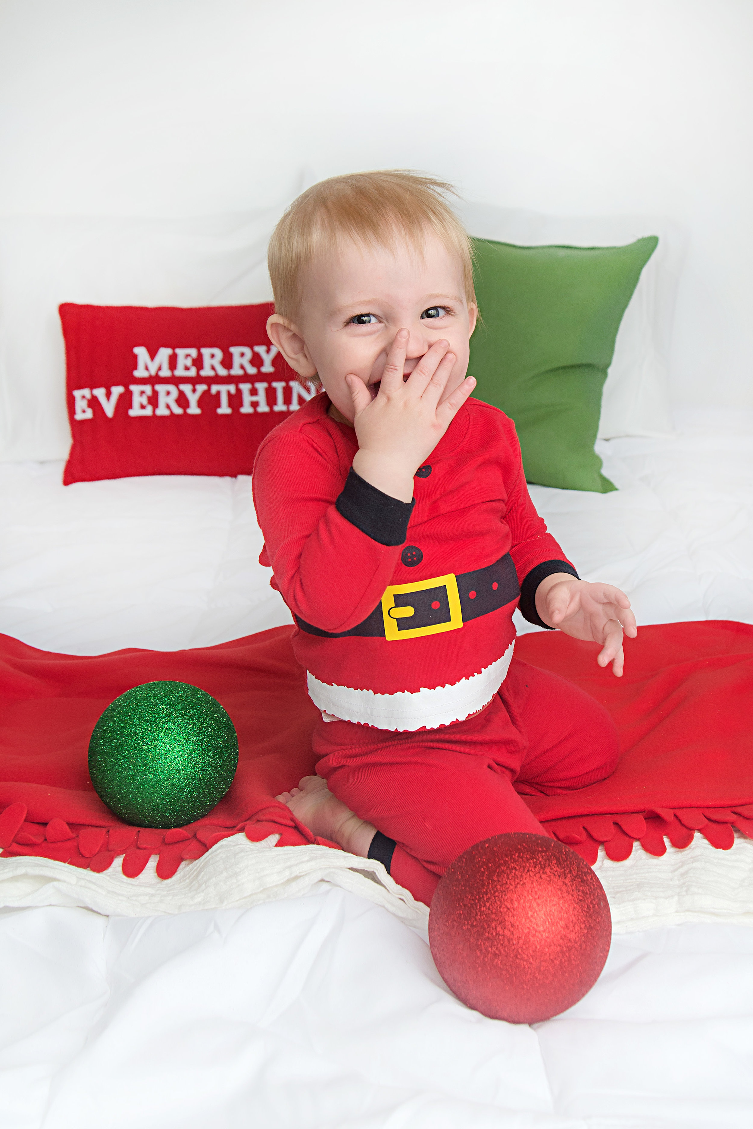 st-louis-photography-studio-christmas-picture-with-one-year-boy-in-santa-pjs.jpg