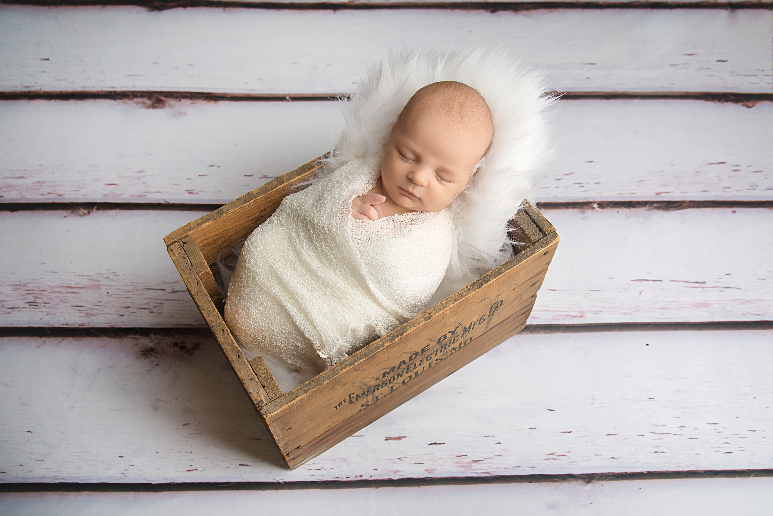 st-louis-newborn-photographer-baby-boy-wrapped-in-white-in-st-louis-emerson-electric-box.jpg