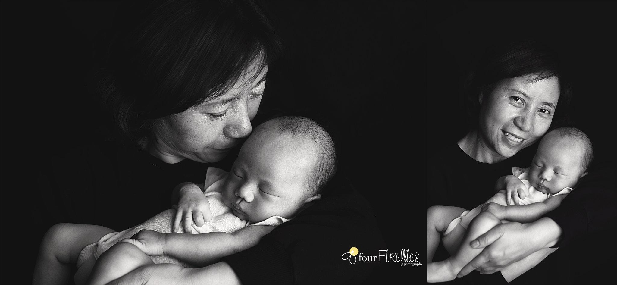 st-louis-newborn-photographer-baby-in-onsie-with-grandma-in-black-and-white.jpg