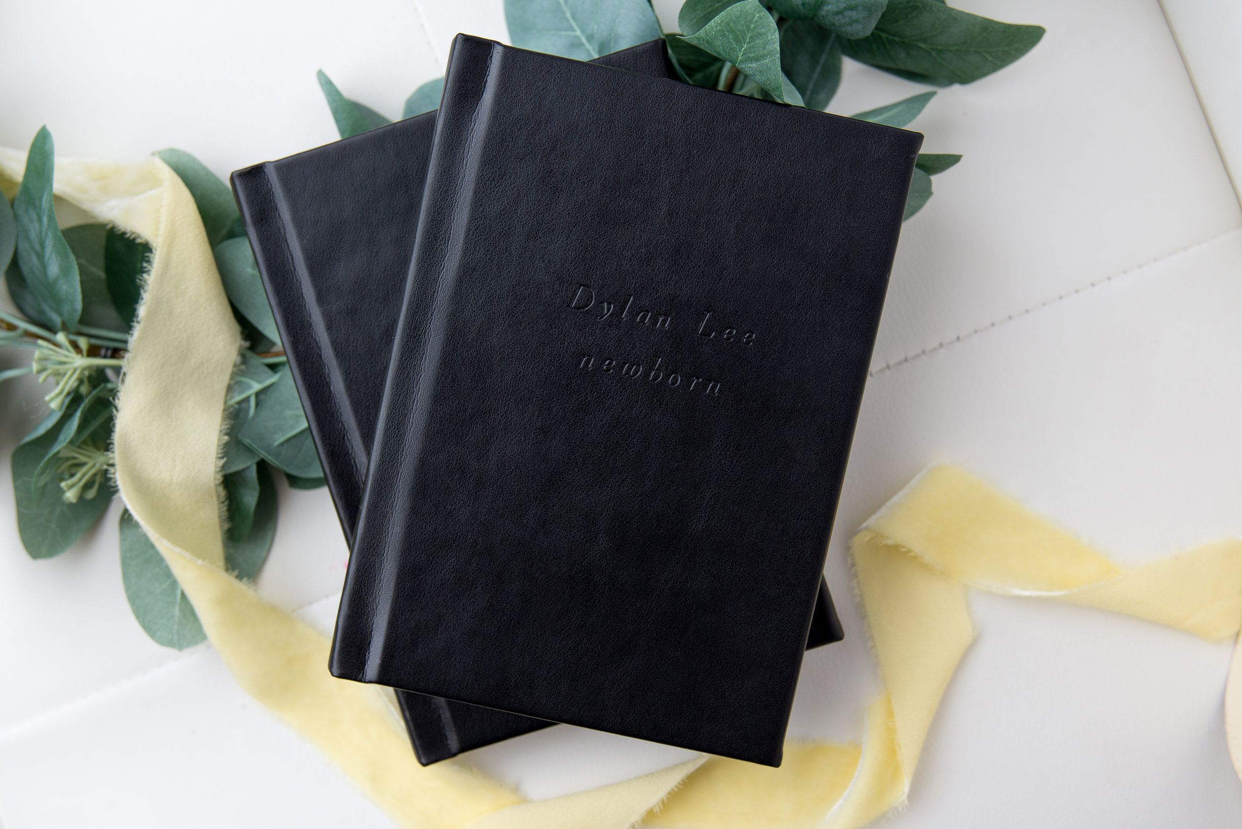 st-louis-photographer-the-session-book-black-book-with-yellow-ribbon-and-greens.jpg