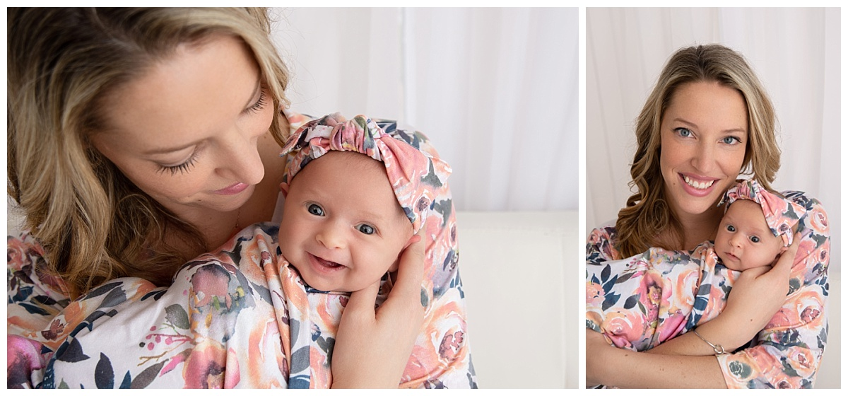 st-louis-newborn-photographer-baby-girl-huge-smile-with-mom-in-matching-floral-robe-and-swaddle.jpg