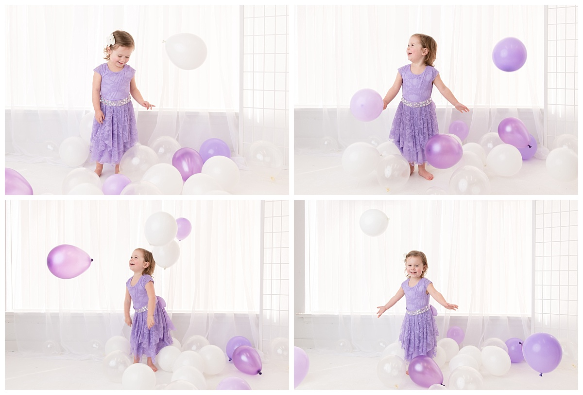 st-louis-birthday-photographer-three-year-old-girl-playing-with-balloons-in-white-room.jpg