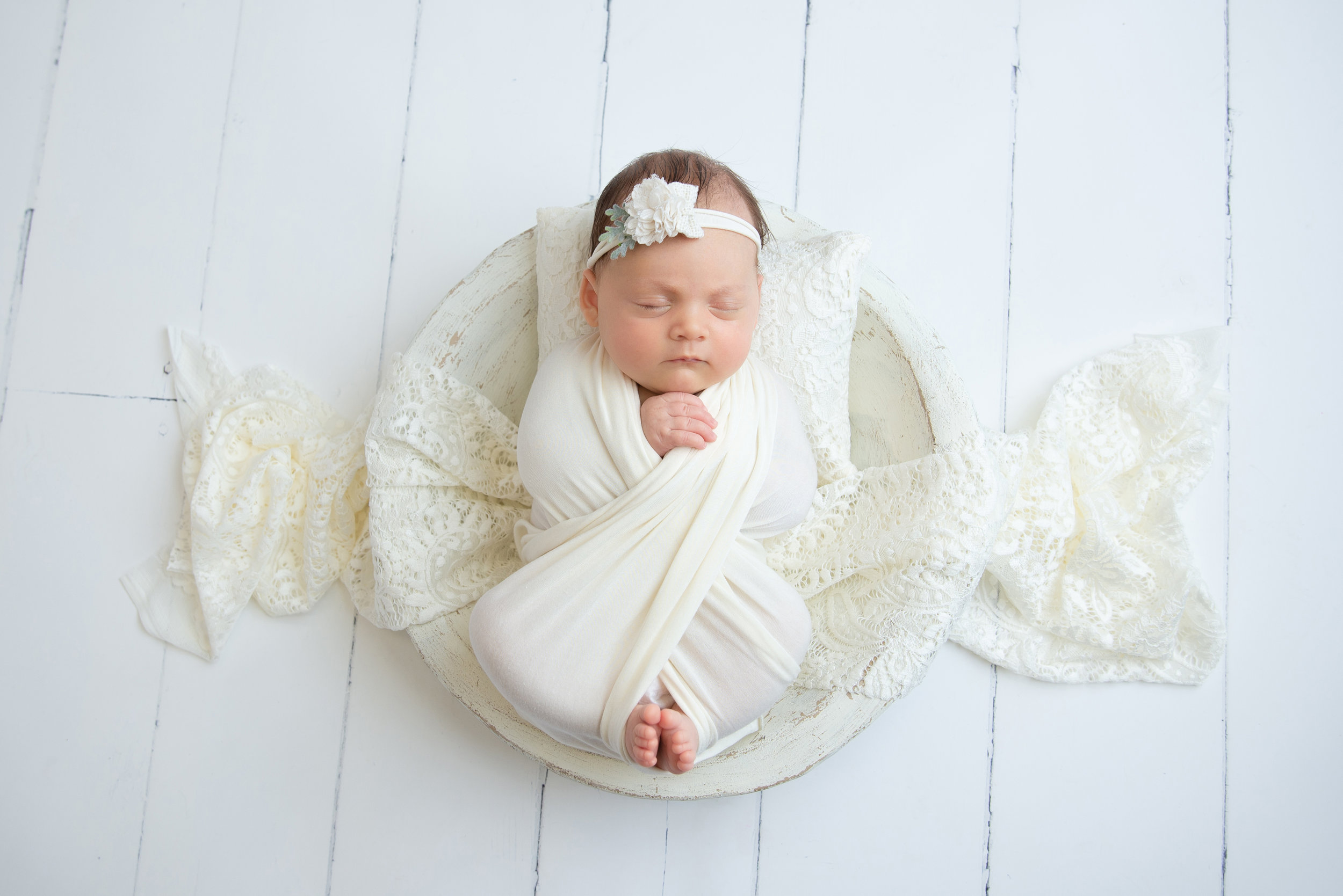st-louis-newborn-photographer-baby-girl-with-differenrt-color-eye-lashes-in-all-neutral-cream-setup.jpg