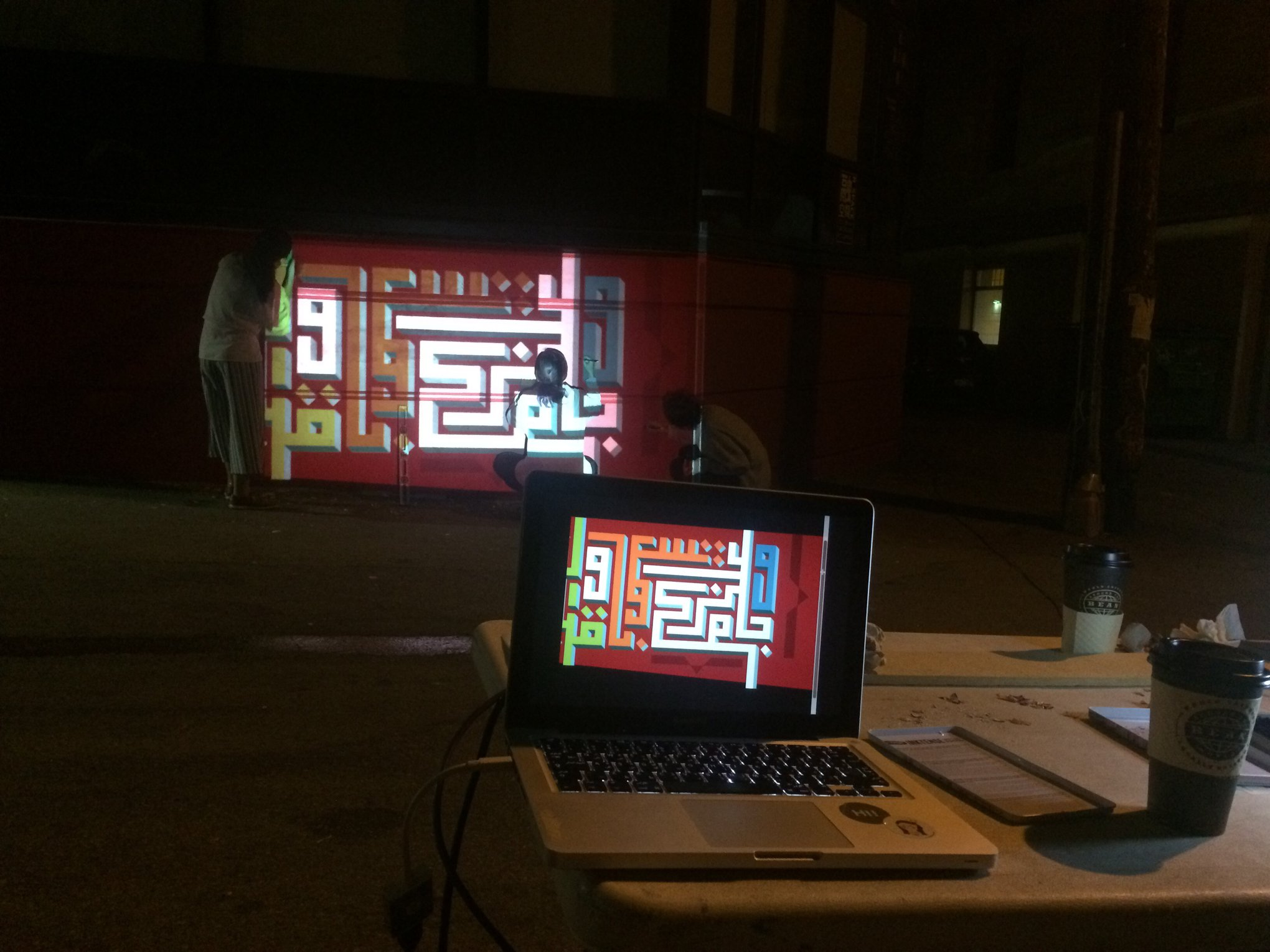 Nighttime projections of the Square Kufic Script.