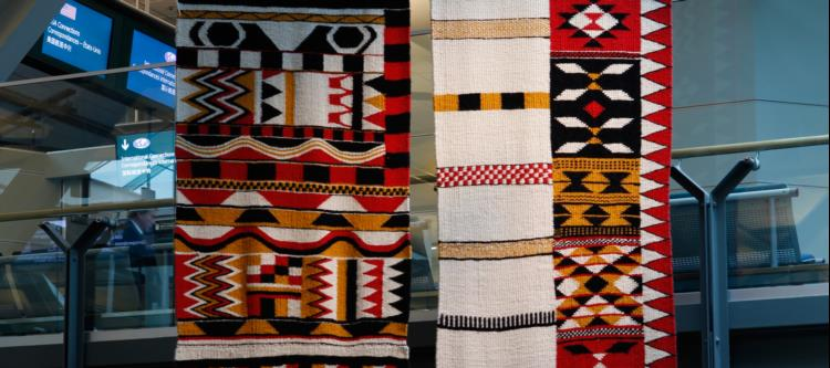 Debra's weavings like these ones that hang in YVR were inspirations for the design of the pillars.