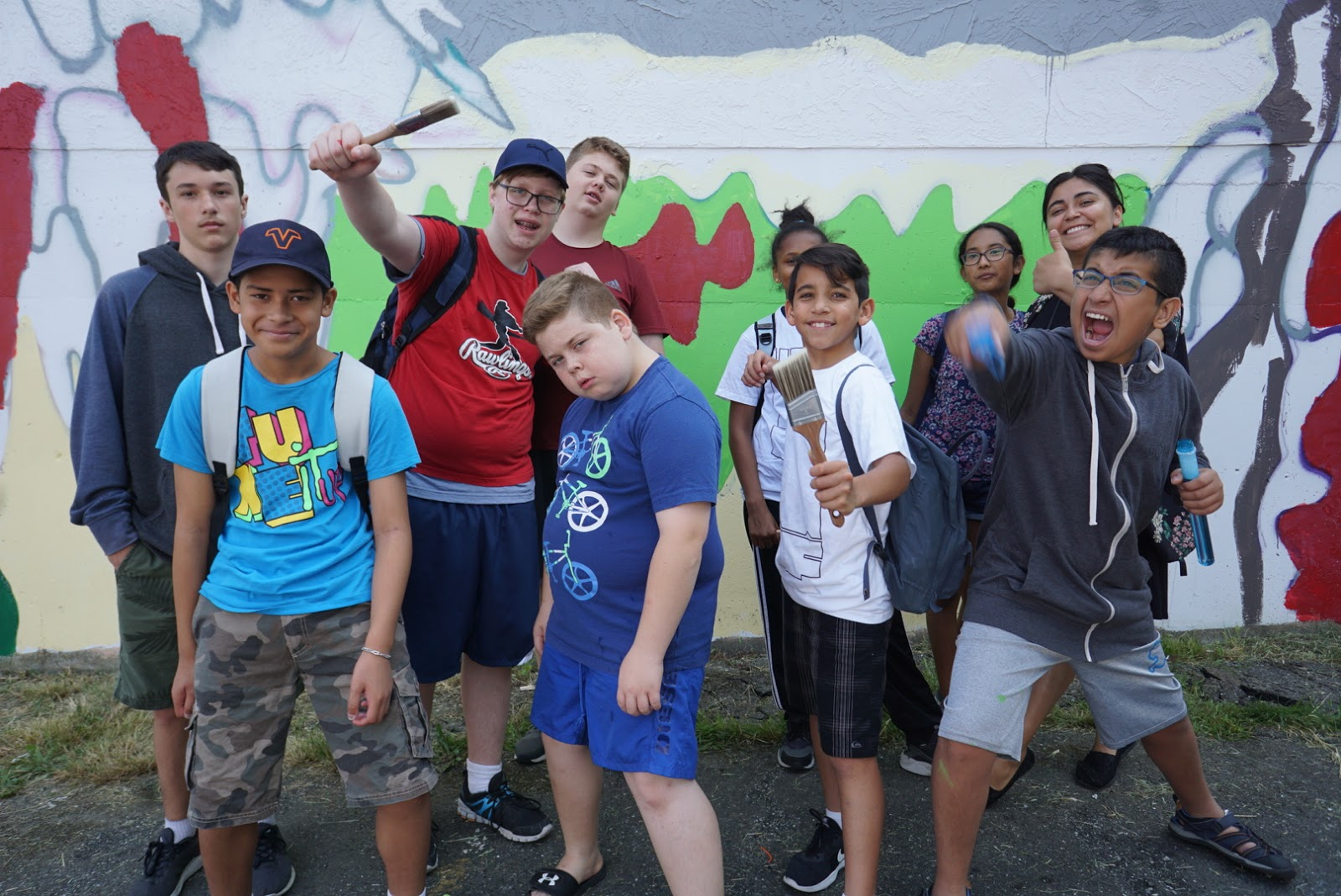Youth from Mount Pleasant Neighbourhood House who helped to paint part of this mural