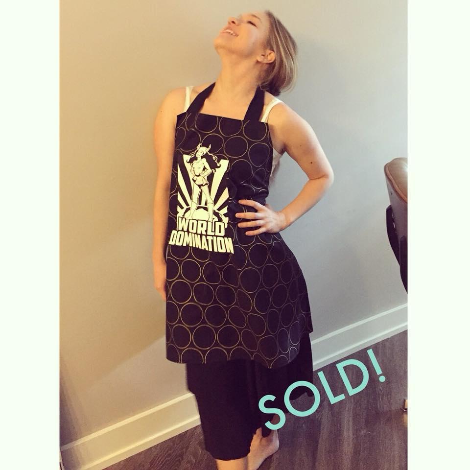 Melanie fiercely modeling the rad AF apron Sews made!