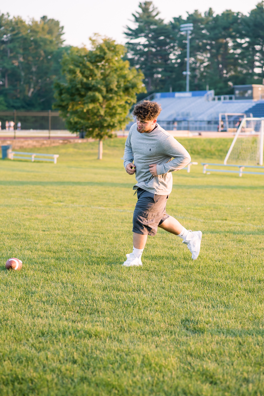 Stoughton High School Senior Guy's buddy runniing for football (2 of 1).jpg