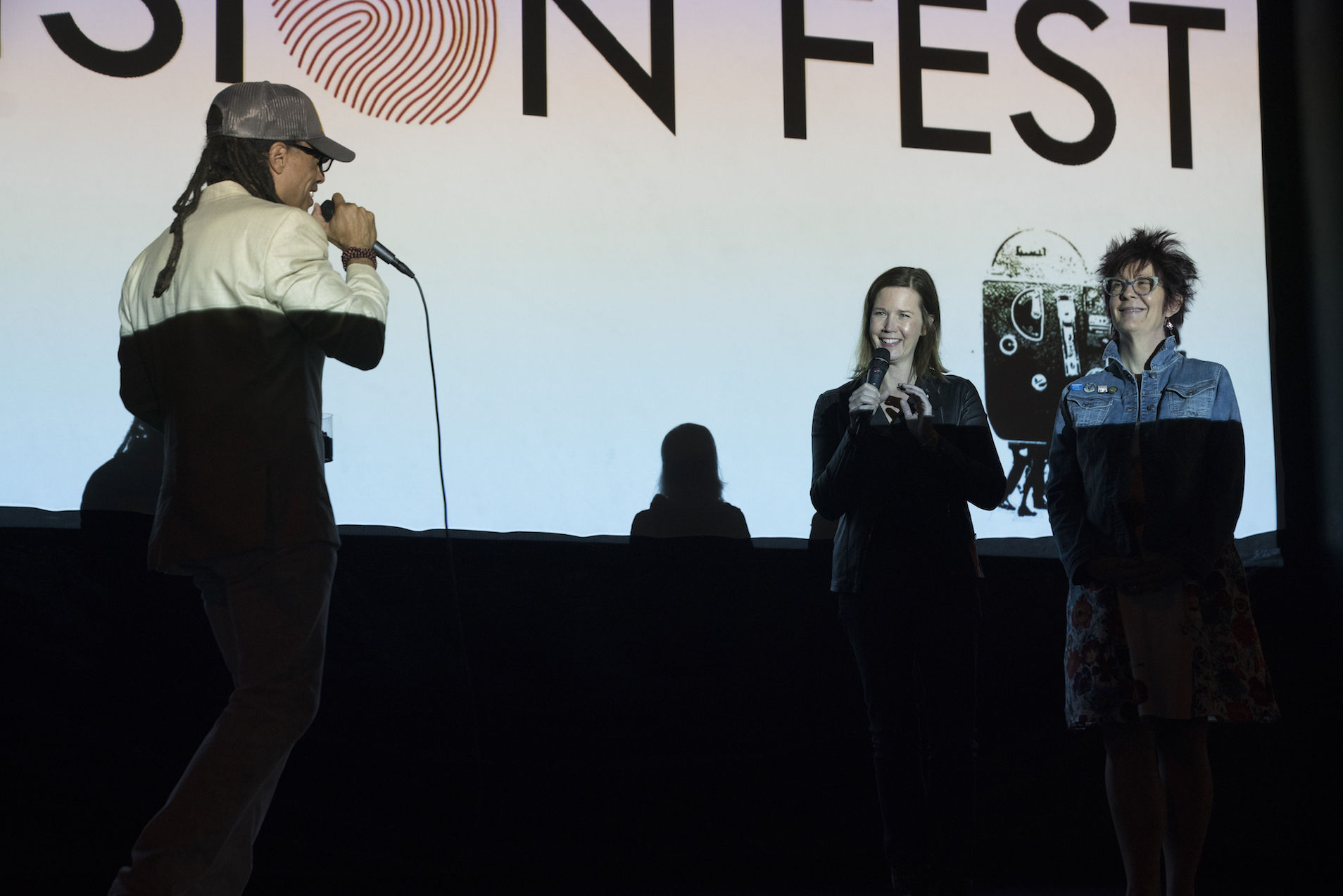 Jacques onstage with Adria and Cindi.jpeg