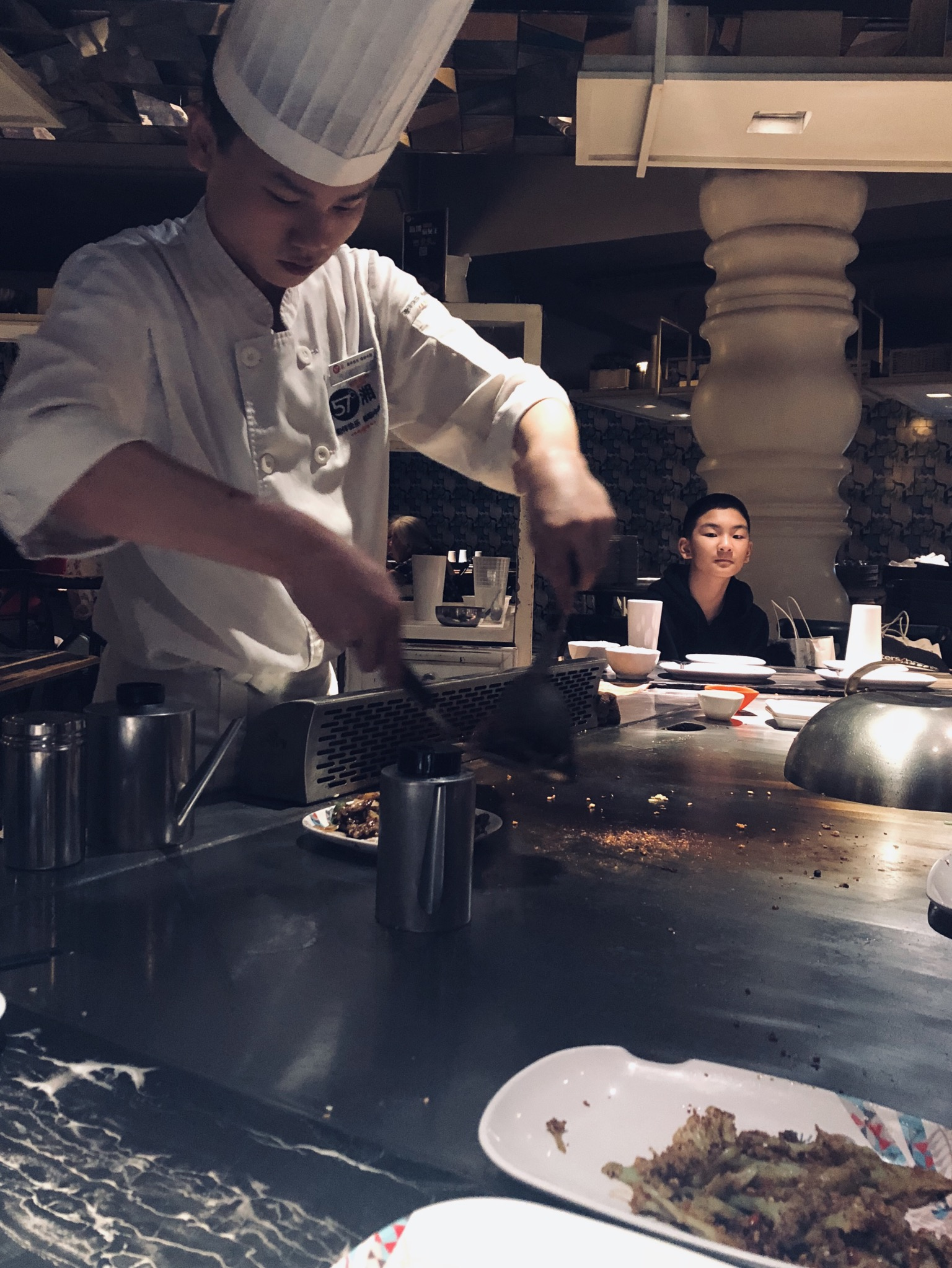 Dancing Chefs at 57°C Xiang Restaurant - Price range: 元元 Moderate but small portions. Location: 57 Xiang, No.195, Section 2, Furong Middle Road, Changsha.Experience something a little different and head over to 57°C Xiang restaurant. You'll sit around an iron plate grill and watch each stage of the cooking process. Be sure to head over around 18:30-19: 00 pm for a chef special dance show!